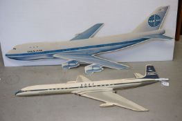 Two Mid 20th century Advertising Cardboard Cut Out Double Sided Signs in the form of Airplanes