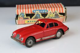 Boxed Scalex tin plate clockwork Aston Martin DB2 model in red, showing play wear with wear to