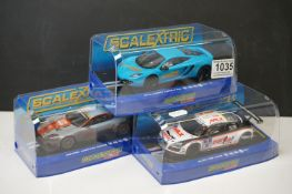 Three cased Scalextric slot cars to include ltd edn C3327 McLaren MP4-12C Scalextric Club 2012,