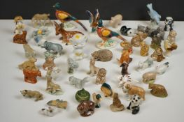 Collection of miniature ceramic animals to include Wade Whimsies etc