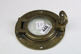 A small brass ships porthole, measures approx 15cm.