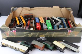 Collection of 38 OO gauge items of rolling stock featuring mainly trucks and wagons to include