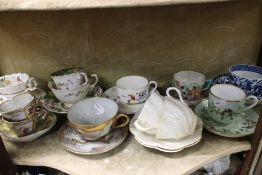 A quantity of cup and saucers to include Minton, Augustus Rex etc.