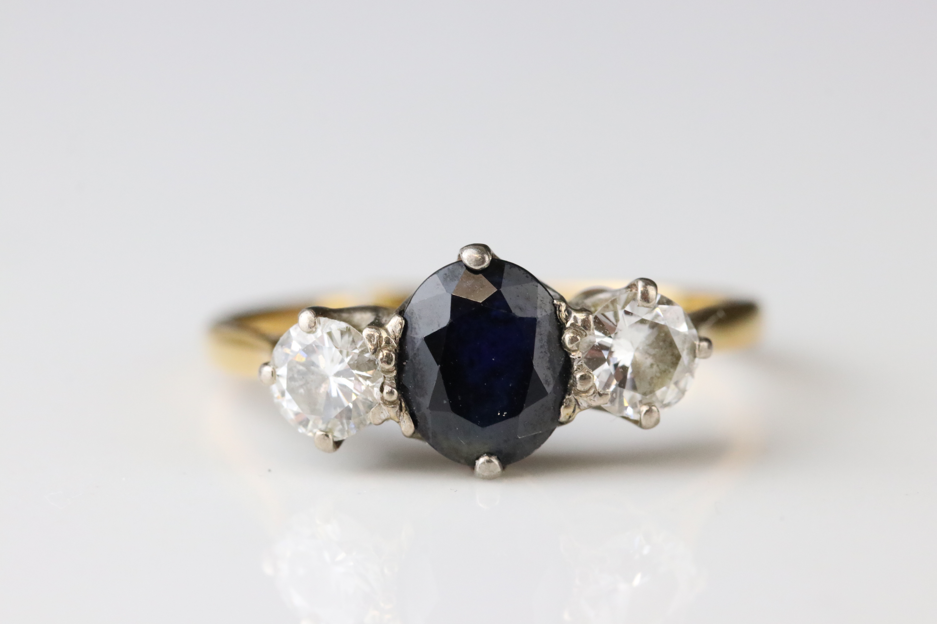Sapphire and diamond three stone 18ct yellow gold platinum set ring, the oval mixed cut blue-black - Image 3 of 5