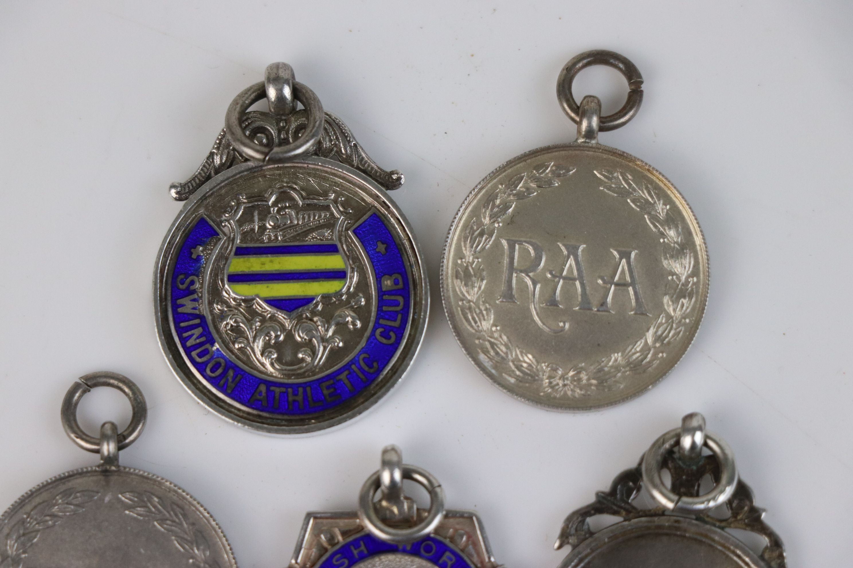A collection of Twelve fully hallmarked sterling silver sports related watch fob medallions. - Image 3 of 9