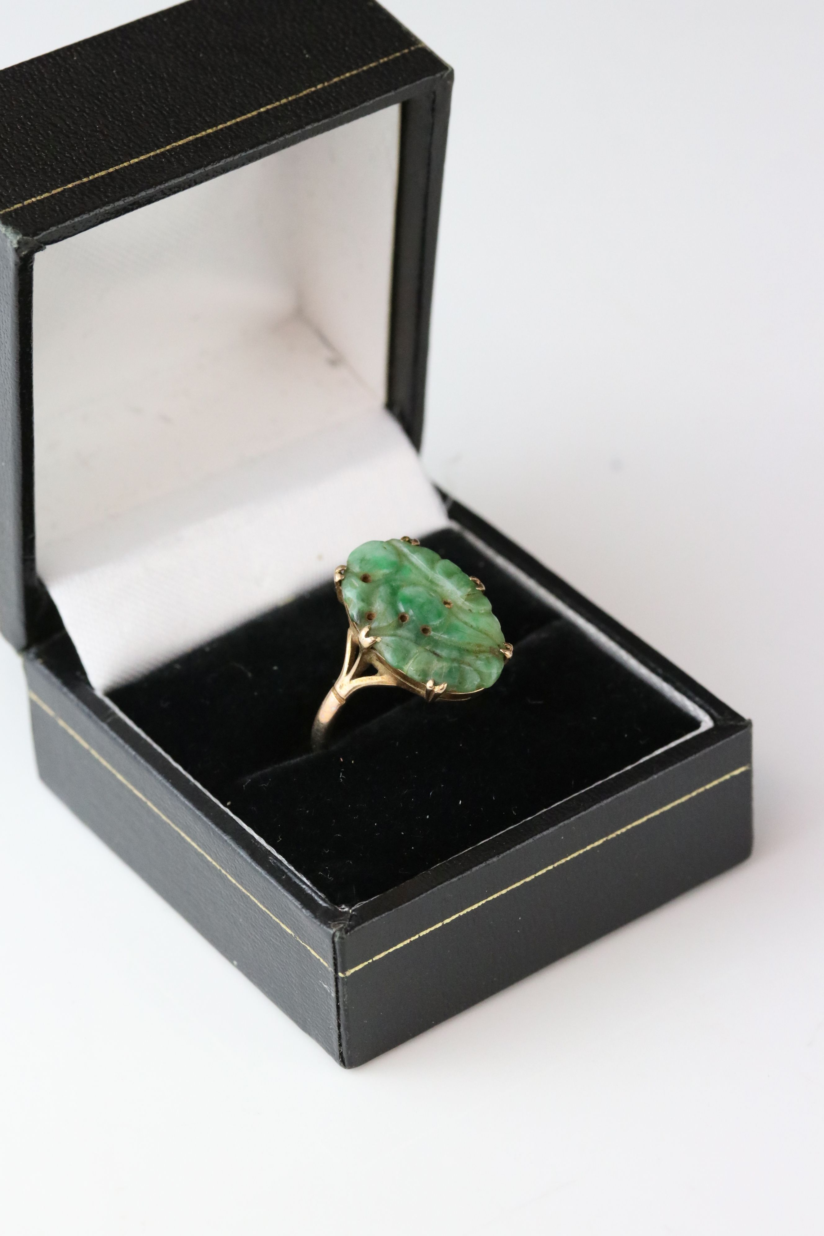 Carved jade 9ct yellow gold ring, the oval pierced carved jade measuring approx 18mm x 11.5mm,