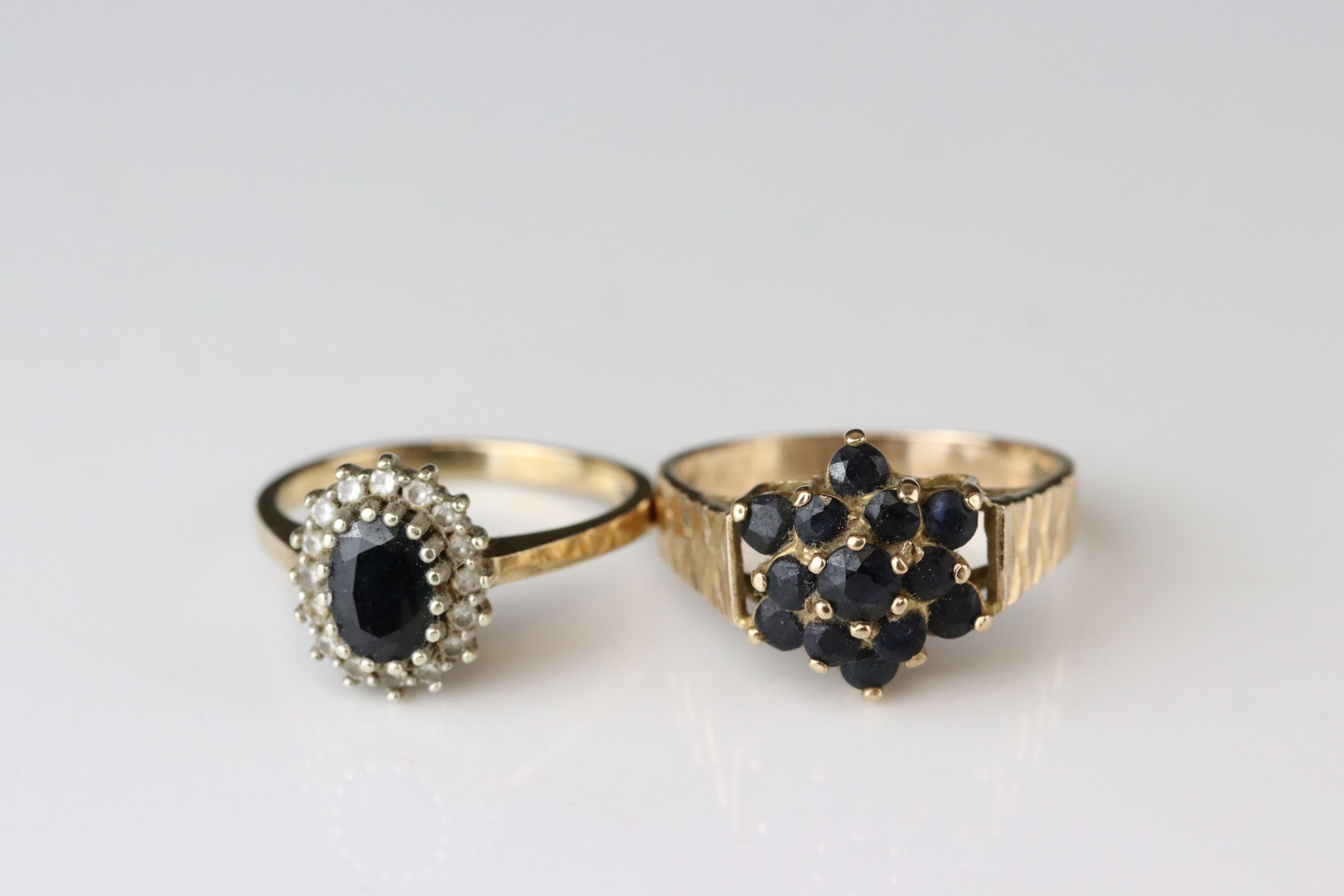 Sapphire 9ct yellow gold cluster ring, together with black sapphire and white stone 9ct yellow - Image 2 of 5