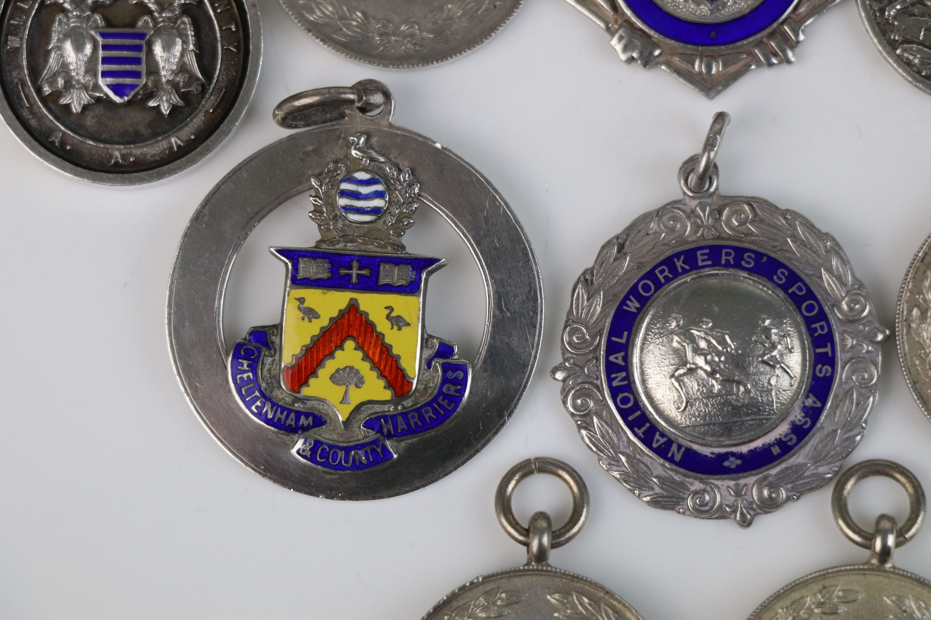 A collection of Twelve fully hallmarked sterling silver sports related watch fob medallions. - Image 7 of 9