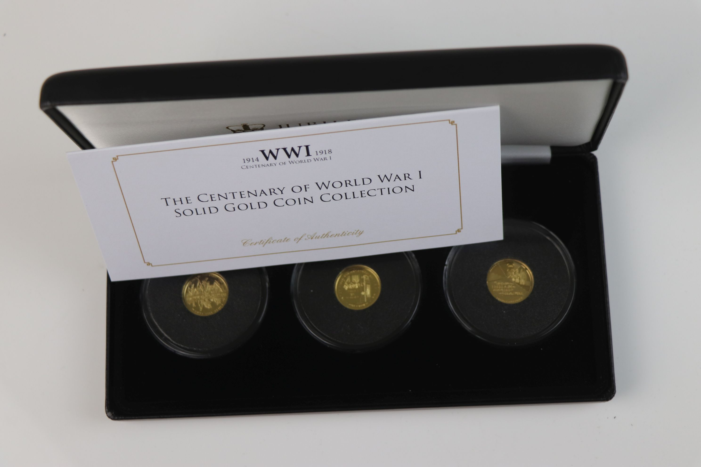 A cased Jubilee Mint limited edition The Centenary of World War One 9ct gold three coin set,