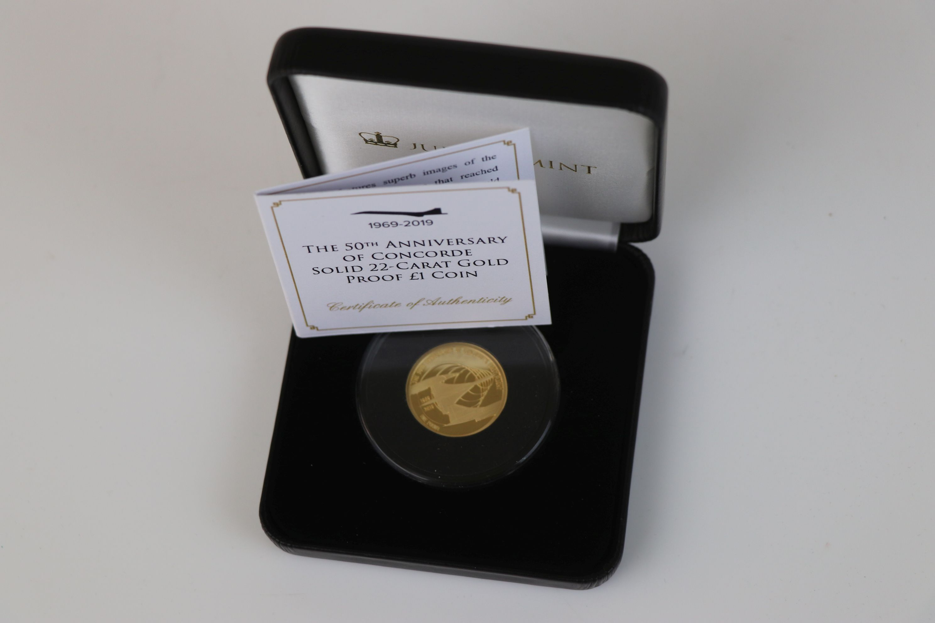 A cased Jubilee Mint The 50th Anniversary of Concorde 22ct gold proof £1 coin, complete with C.O.