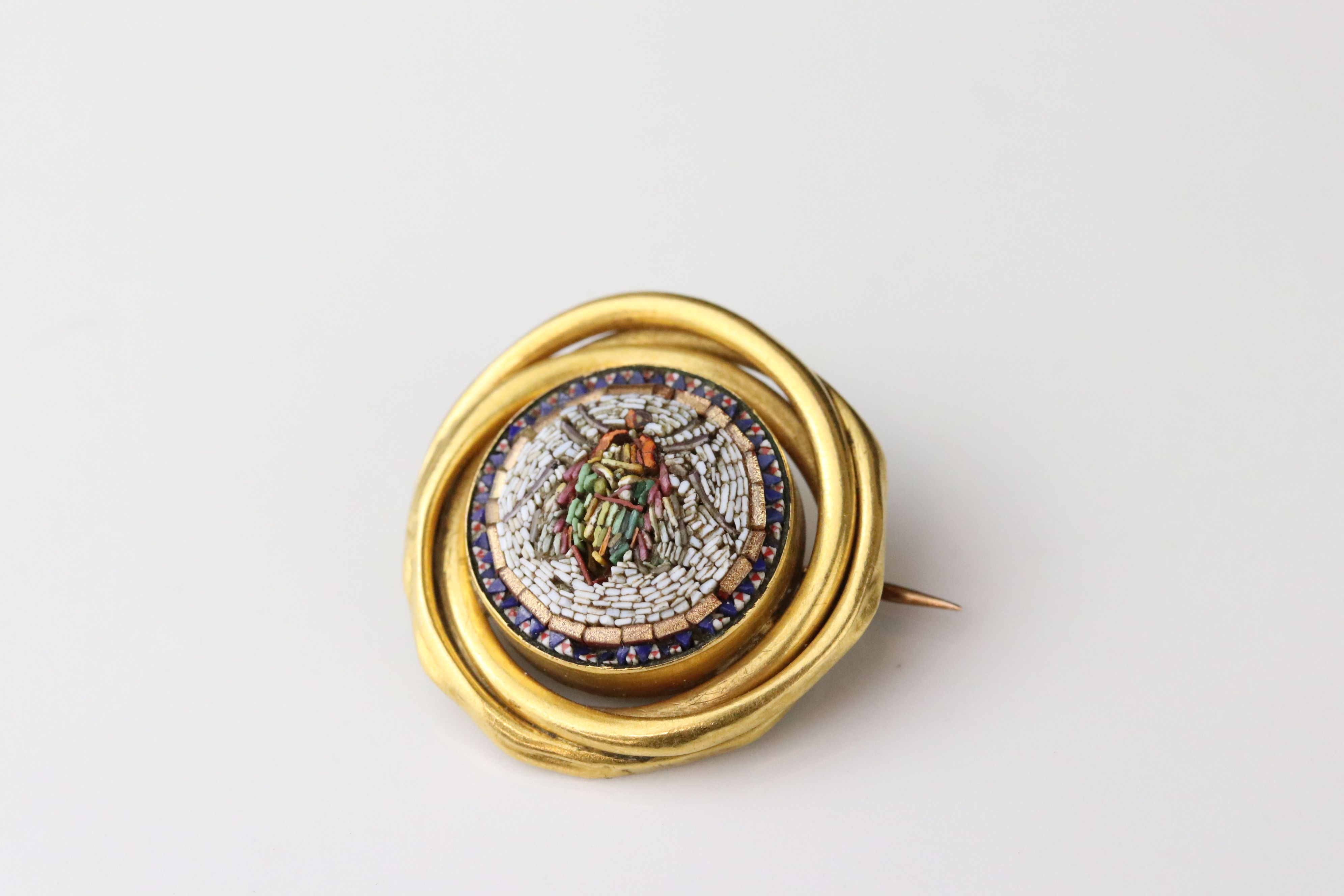 Victorian style micro-mosaic brooch depicting a fly, interwoven yellow metal surround, hinged pin