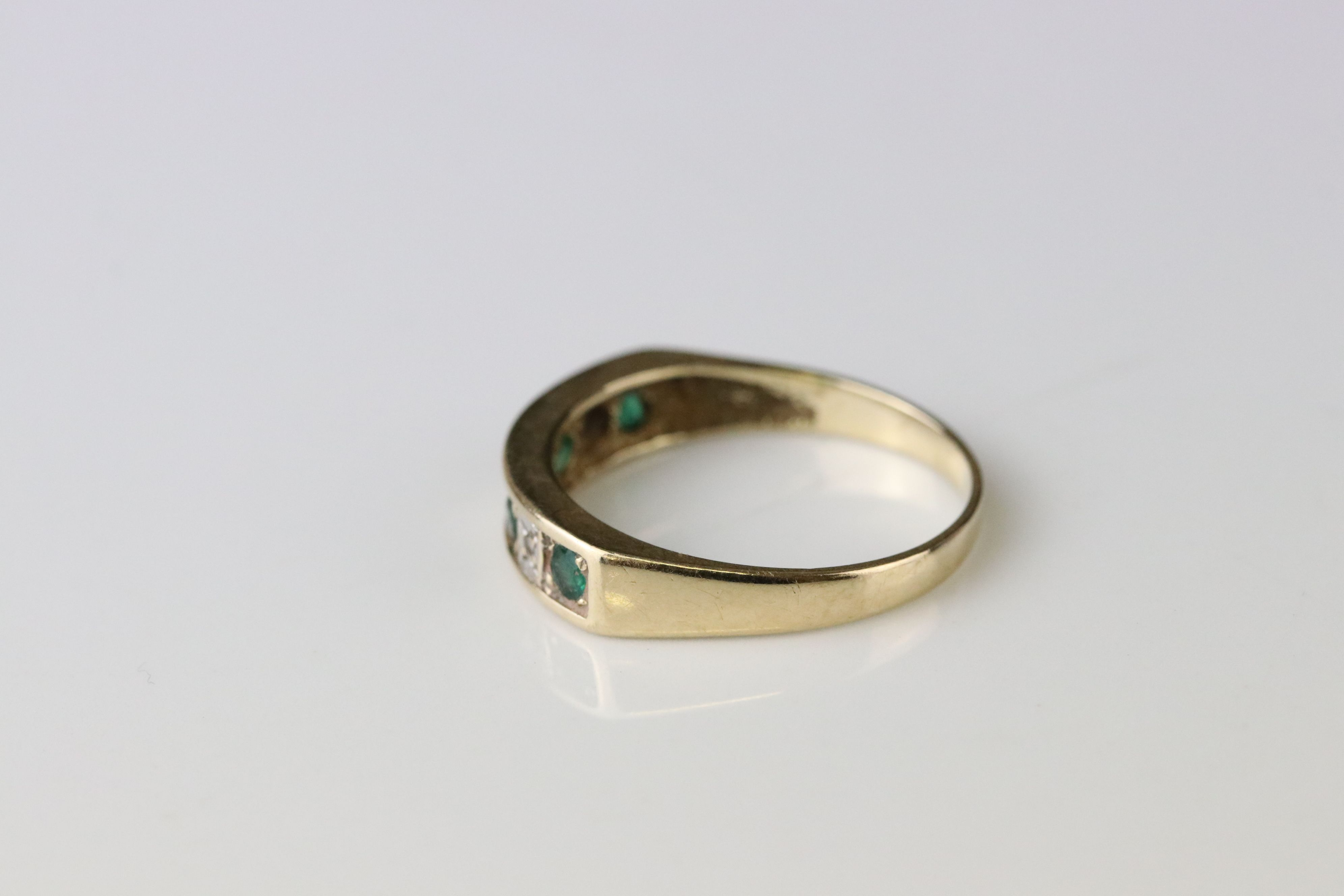 Emerald and diamond seven stone ring, four small round mixed cut emeralds and four small eight cut - Image 4 of 4