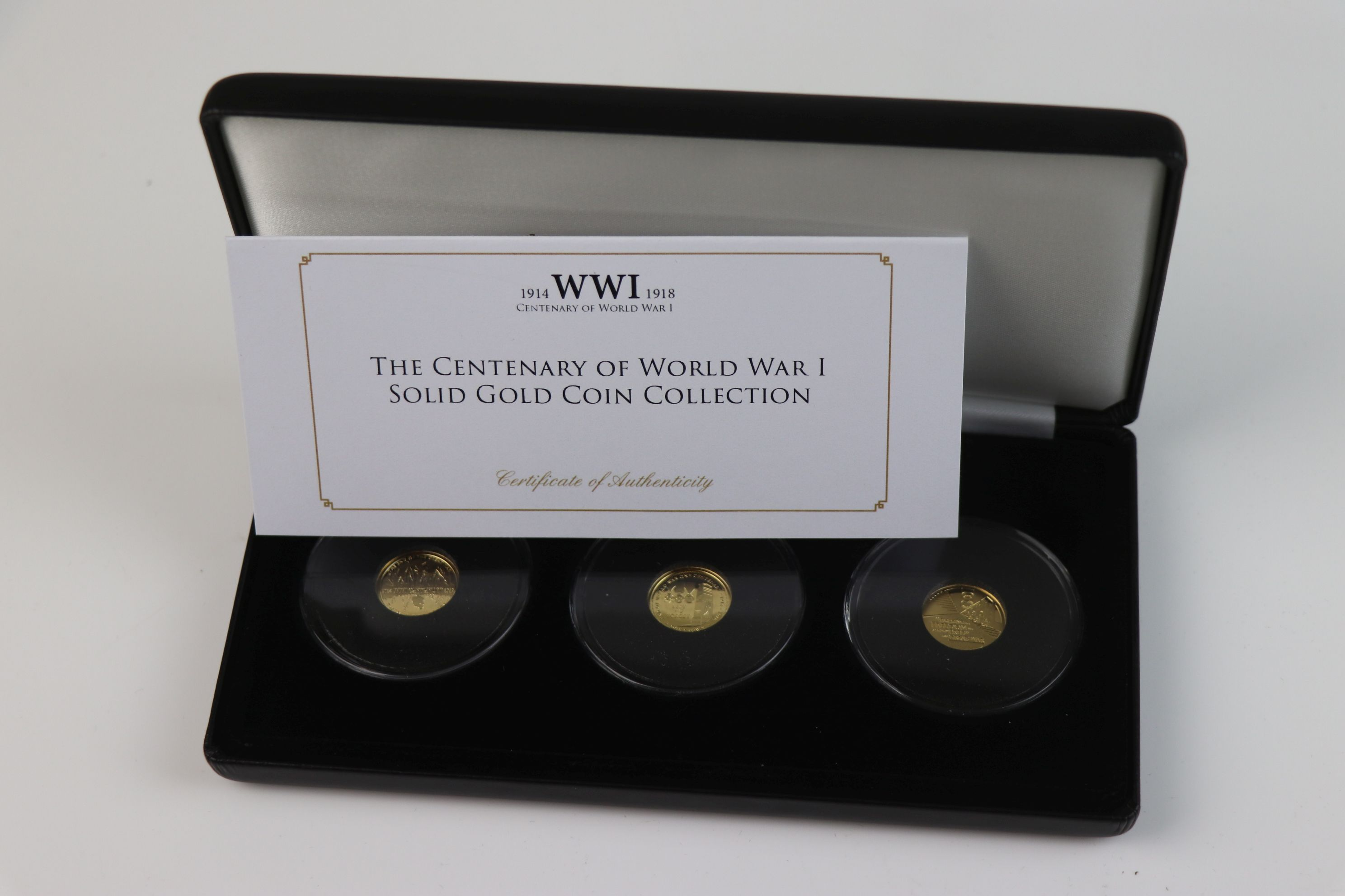 A cased Jubilee Mint limited edition The Centenary of World War One 9ct gold three coin set, - Image 2 of 7