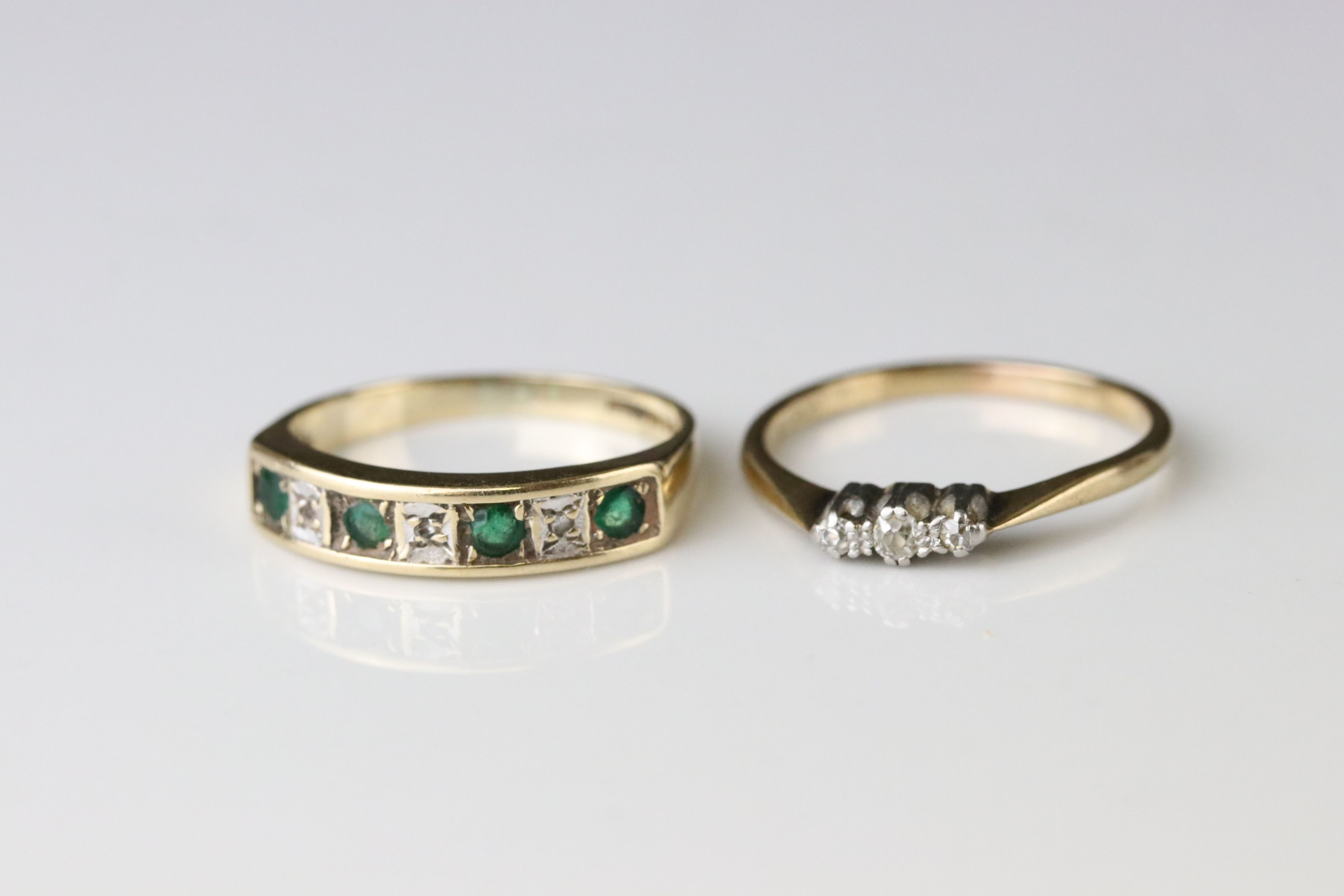 Emerald and diamond seven stone ring, four small round mixed cut emeralds and four small eight cut