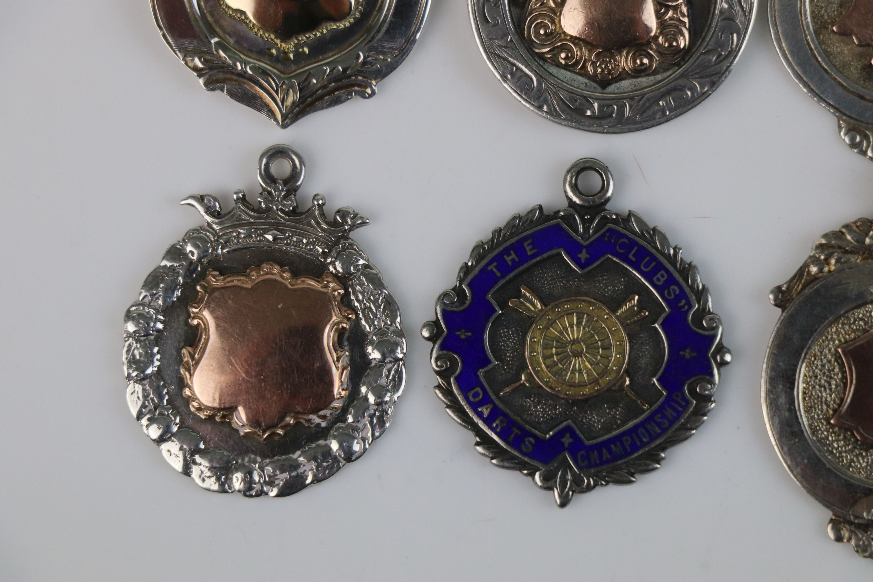 A collection of six fully hallmarked sterling silver watch fob medallions. - Image 5 of 7