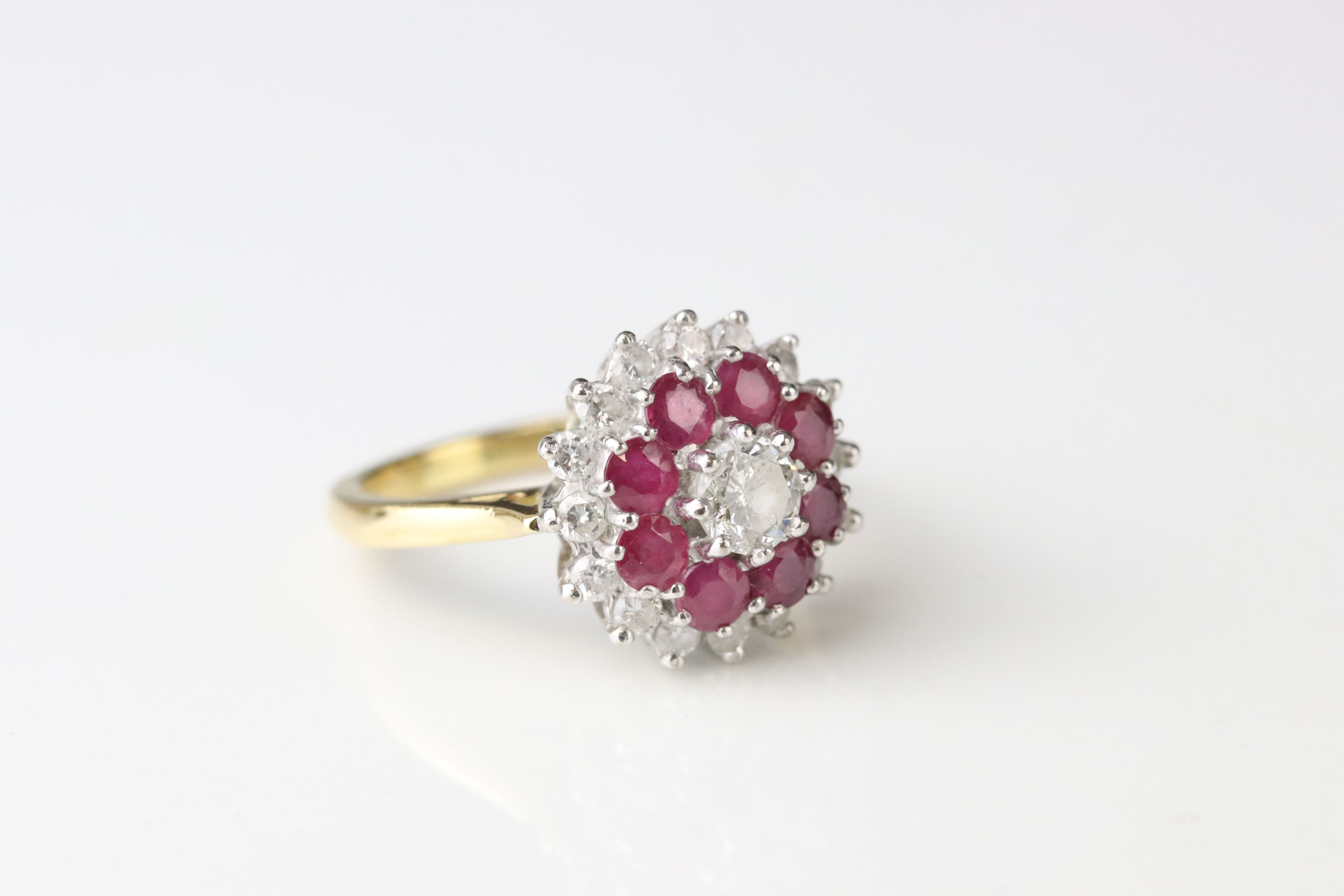 Diamond and ruby three tier 18ct yellow gold and white gold set cluster ring, the principle