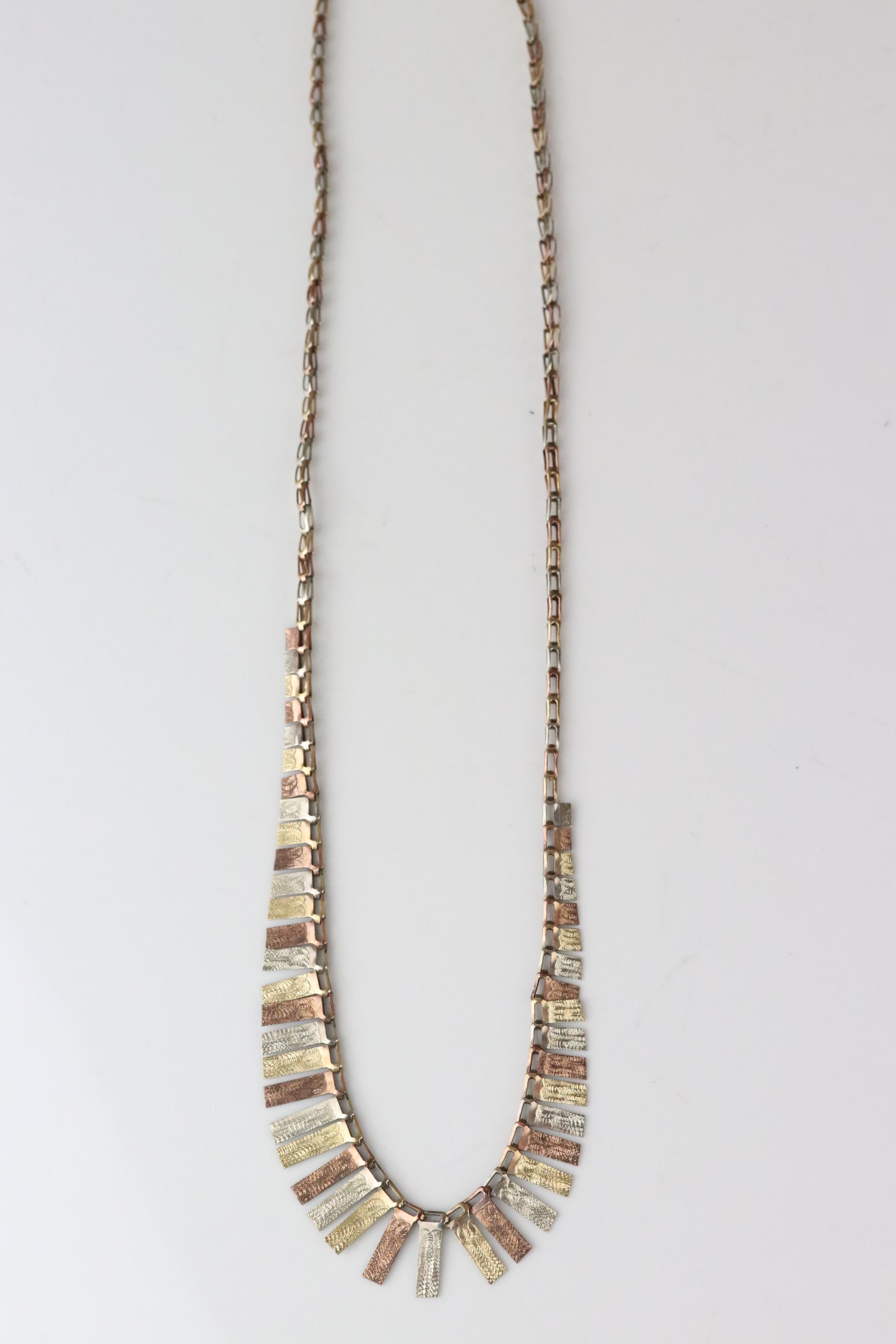9ct tri colour gold fringe necklace, texture rose, yellow and white gold graduated panels, length