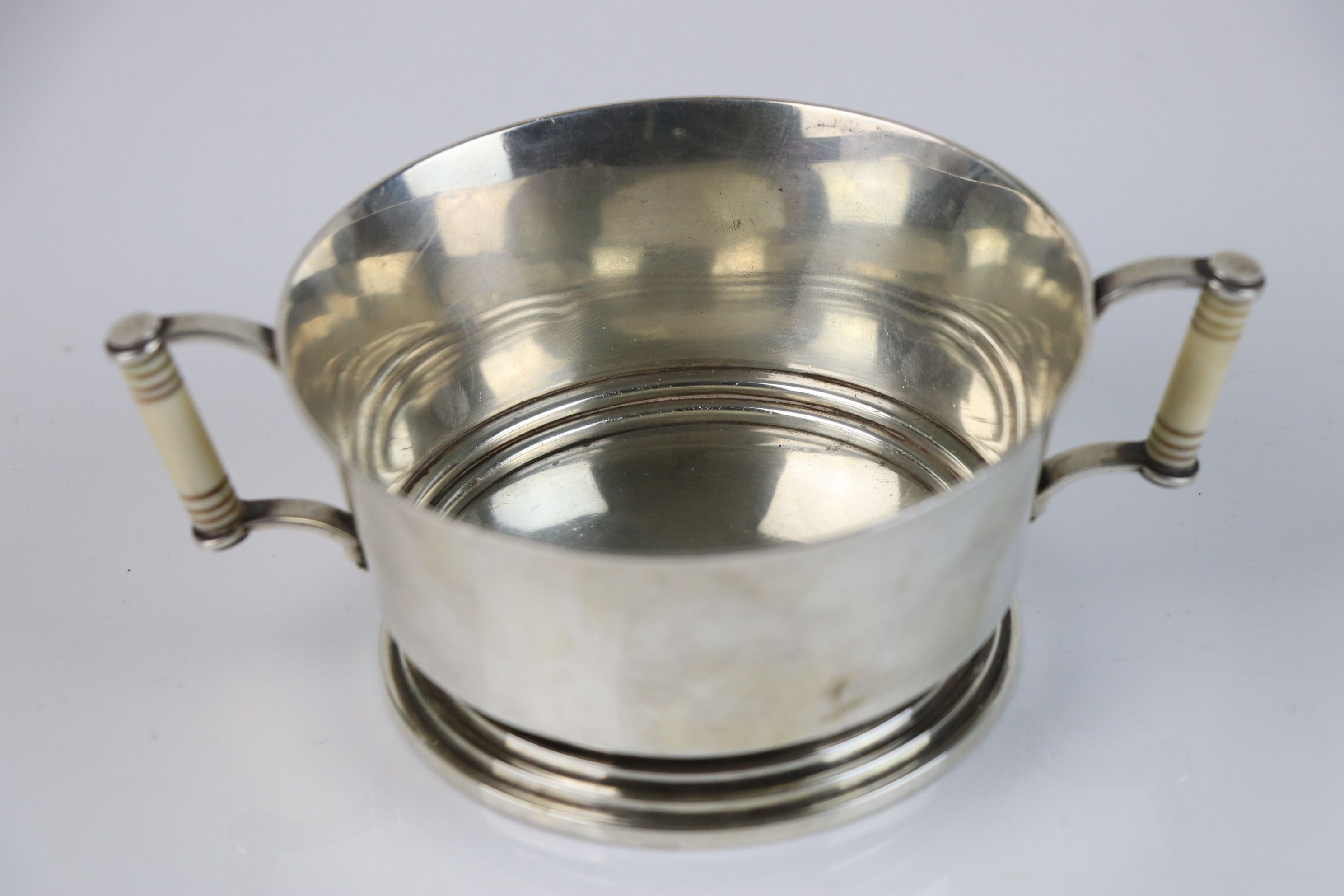 A fully hallmarked Britannia silver double handled christening cup with decorative ivory handles,