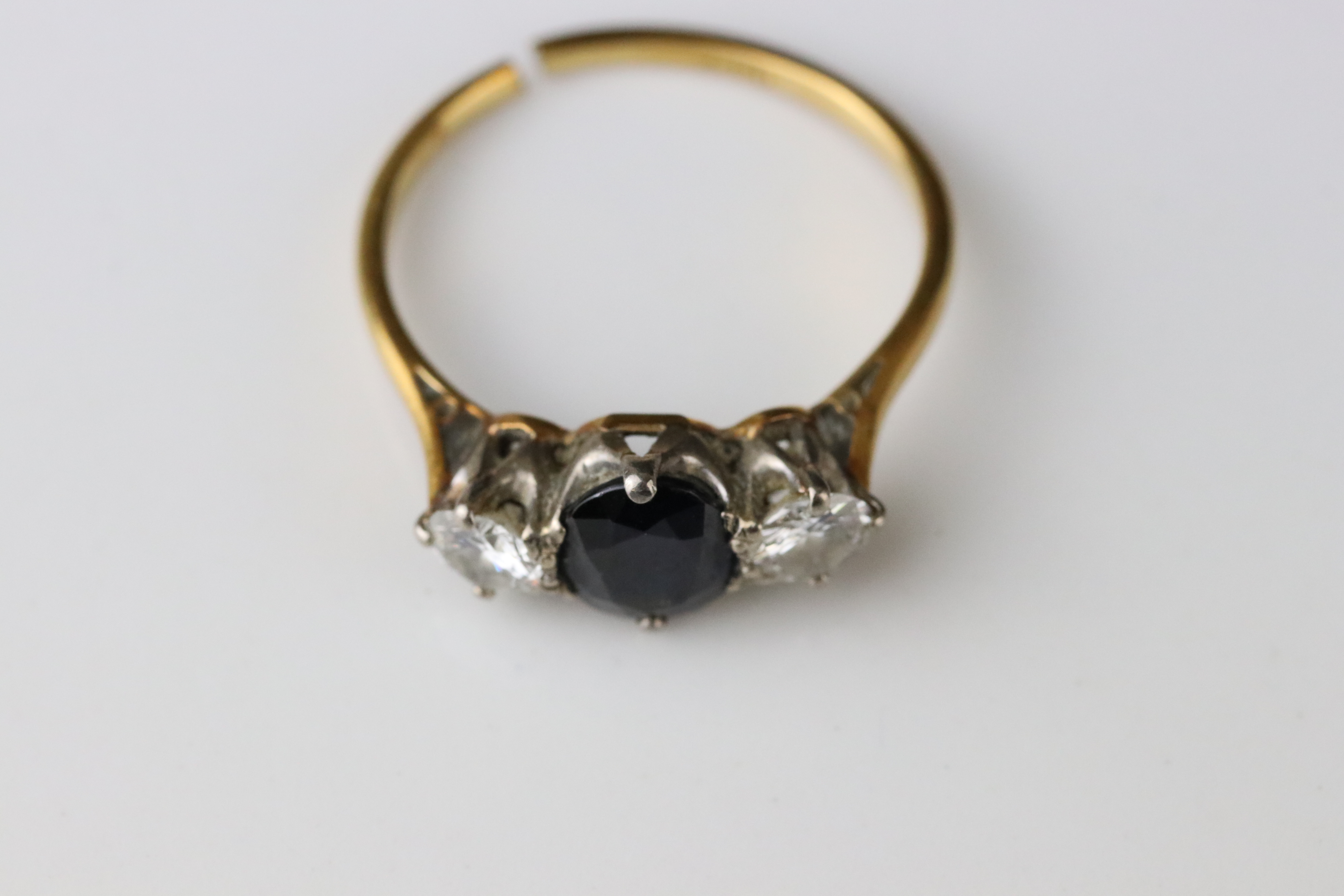 Sapphire and diamond three stone 18ct yellow gold platinum set ring, the oval mixed cut blue-black - Image 4 of 5