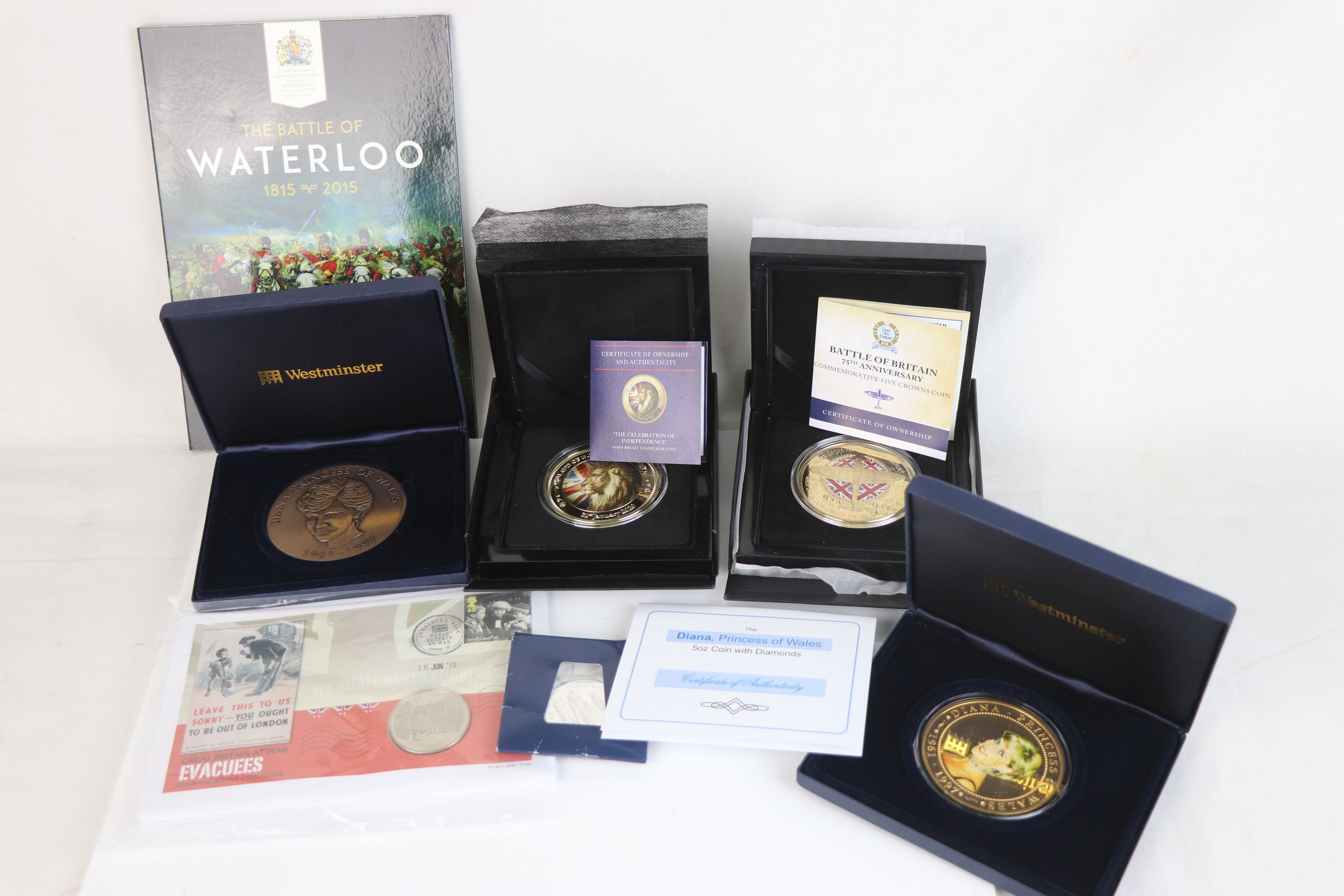 A collection of commemorative coins and medallions to include Battle of Britain Five crown coin,