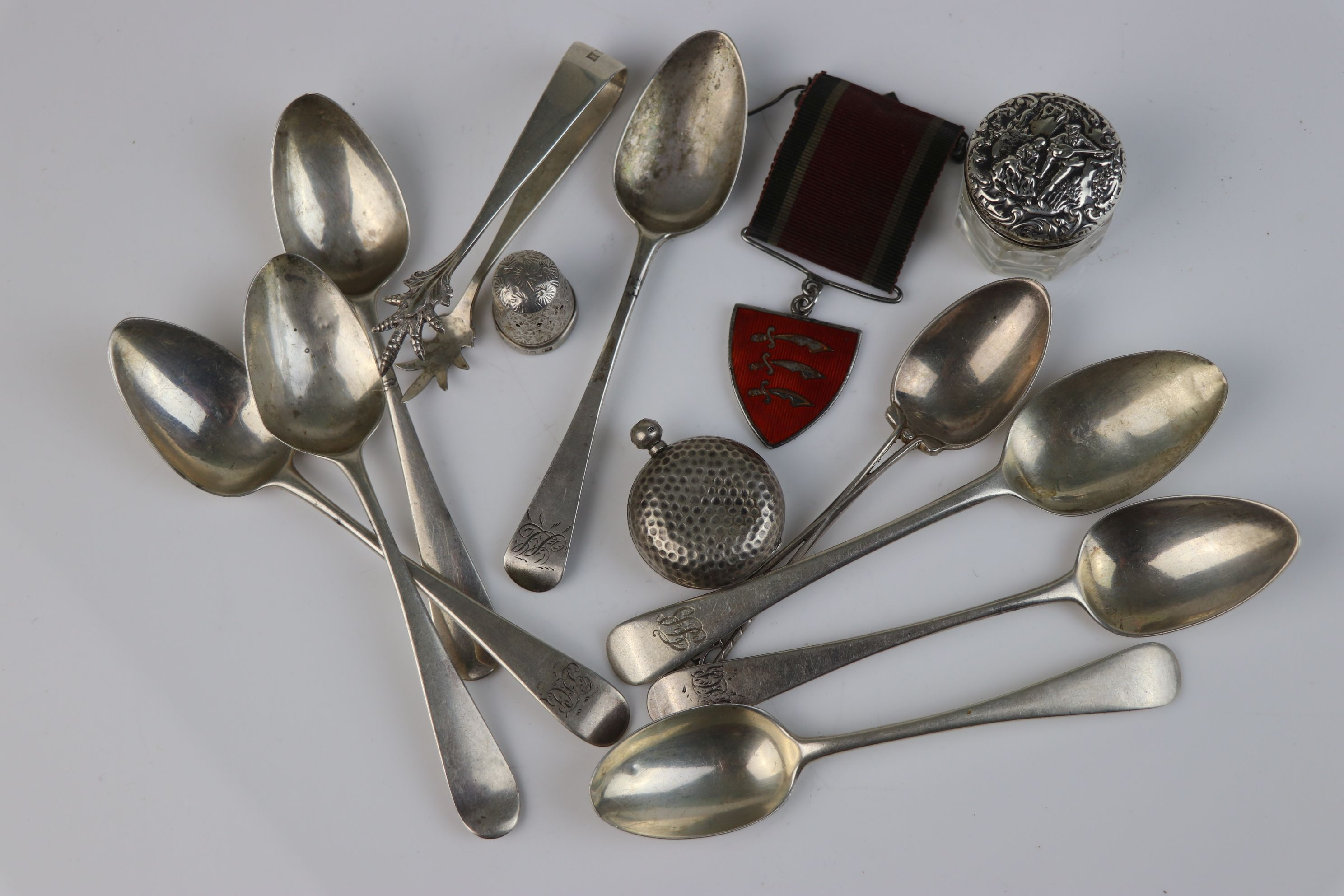 A collection of fully hallmarked sterling silver to include teaspoons, sugar tongs, sovereign case