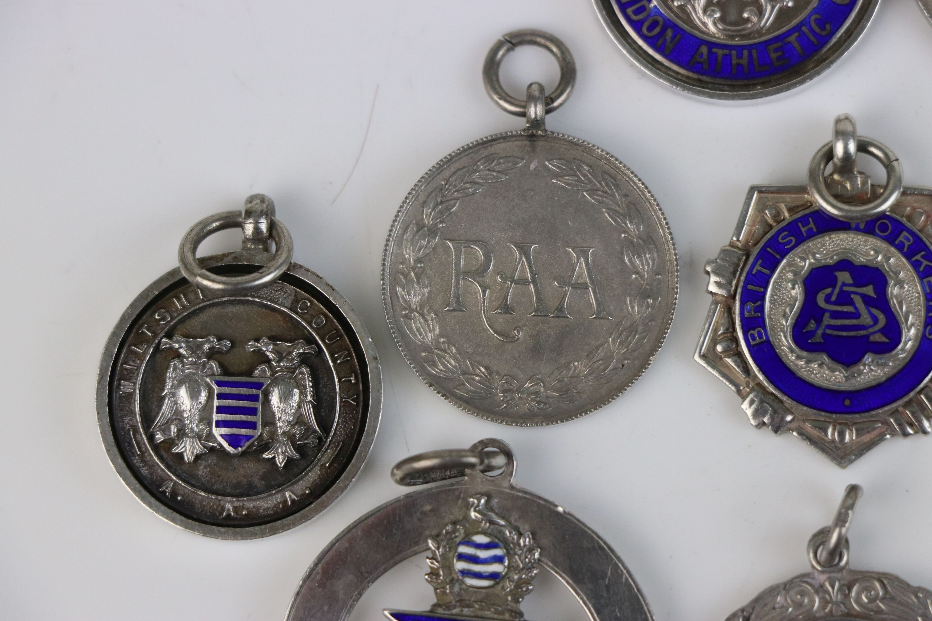 A collection of Twelve fully hallmarked sterling silver sports related watch fob medallions. - Image 4 of 9