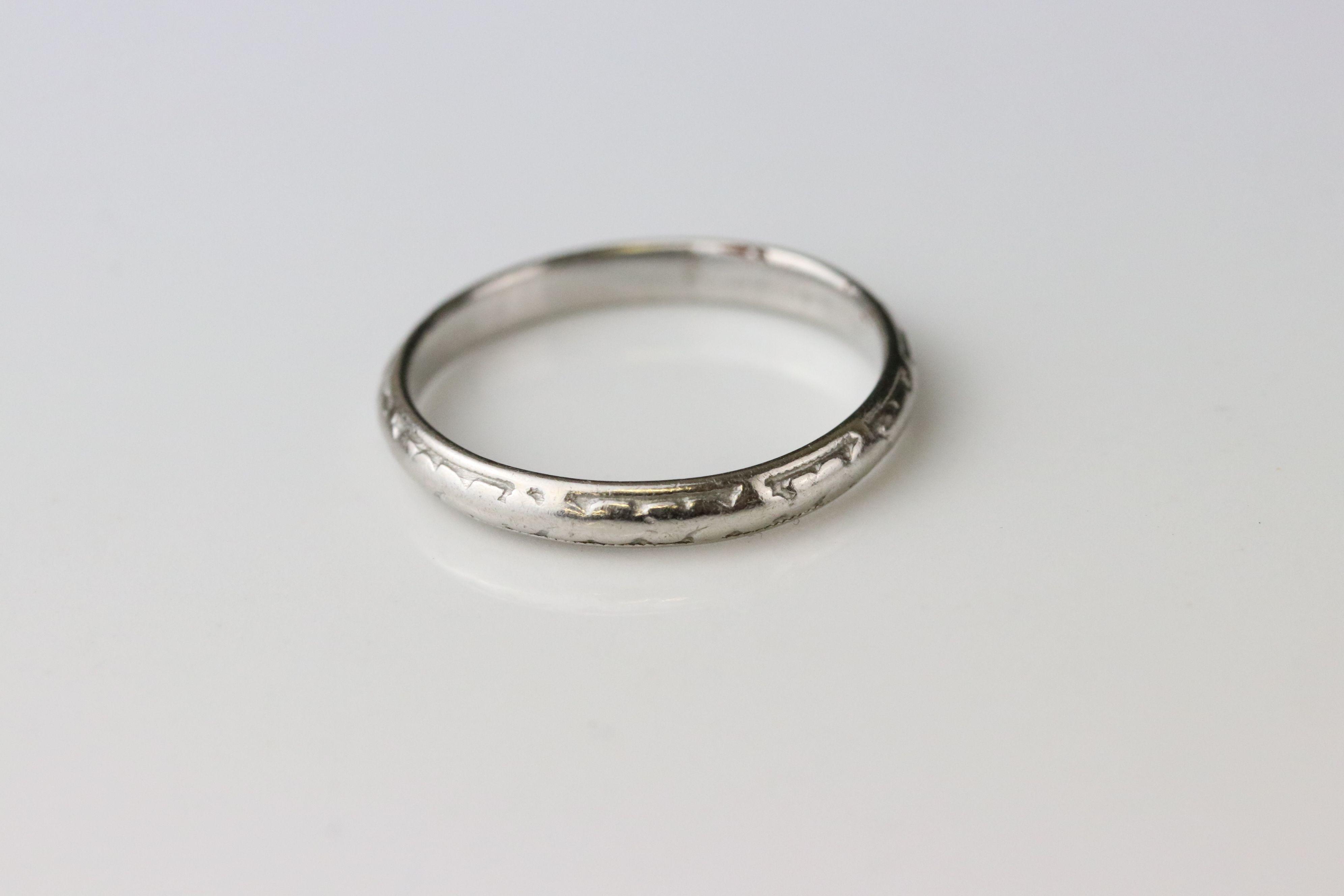 Platinum wedding band, worn foliate design, width approx 2.5mm, ring size M