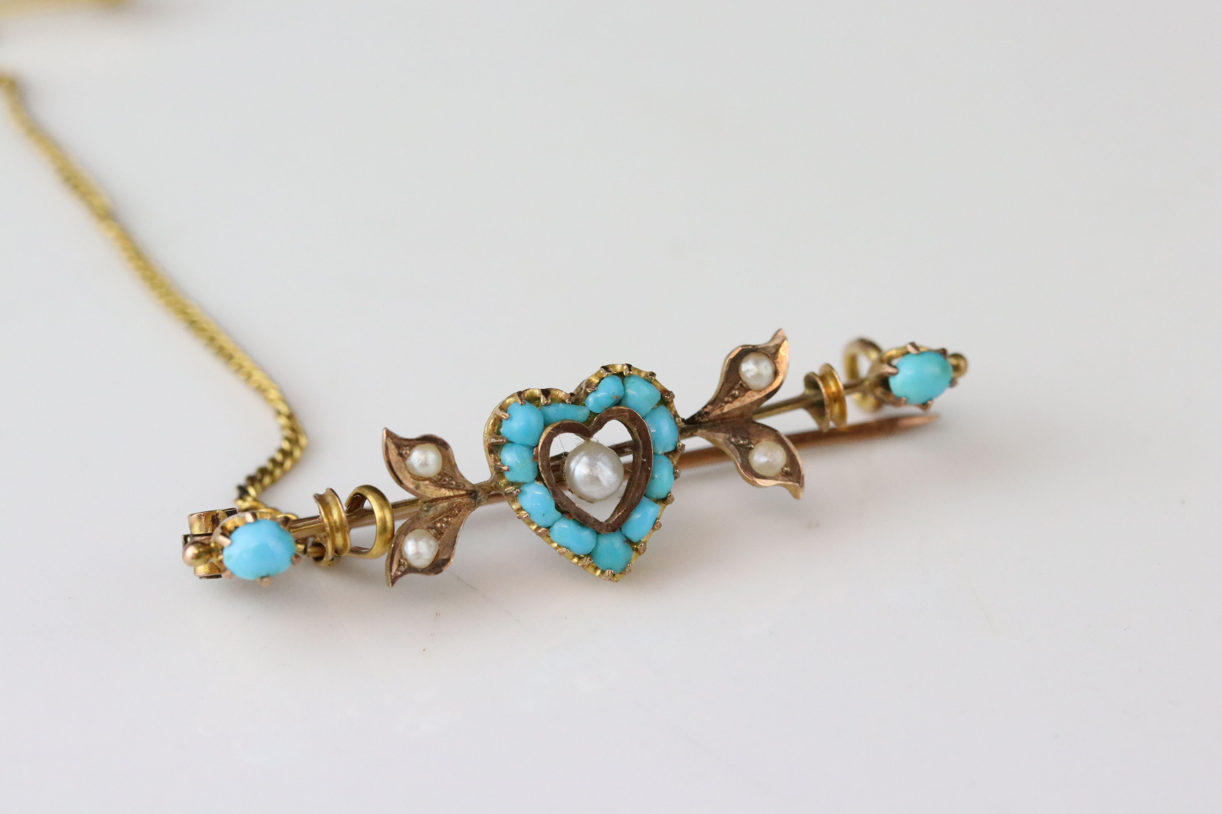 German 19th century turquoise and seed pearl 8ct gold sweetheart brooch, the central heart-shaped
