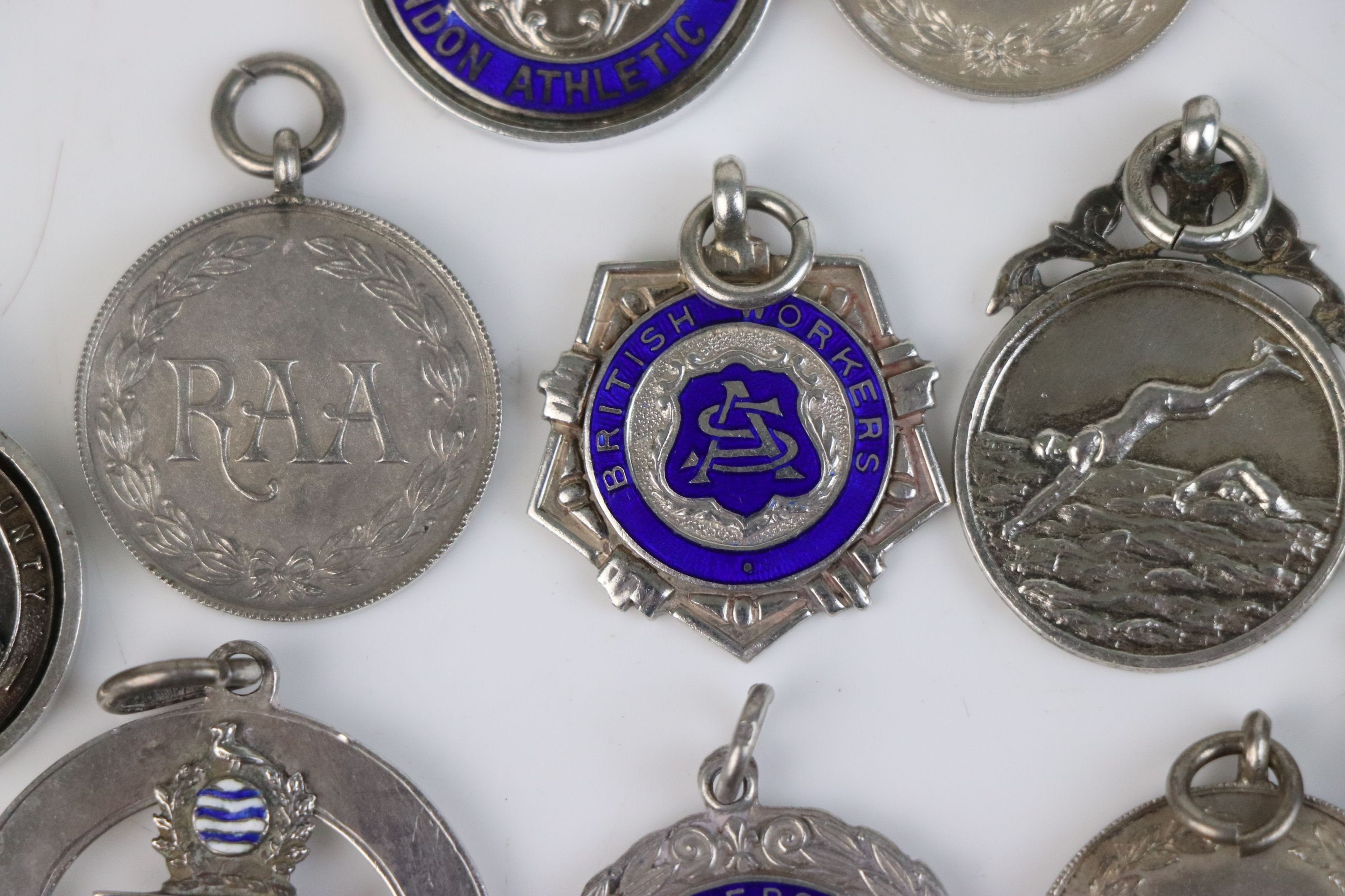 A collection of Twelve fully hallmarked sterling silver sports related watch fob medallions. - Image 5 of 9