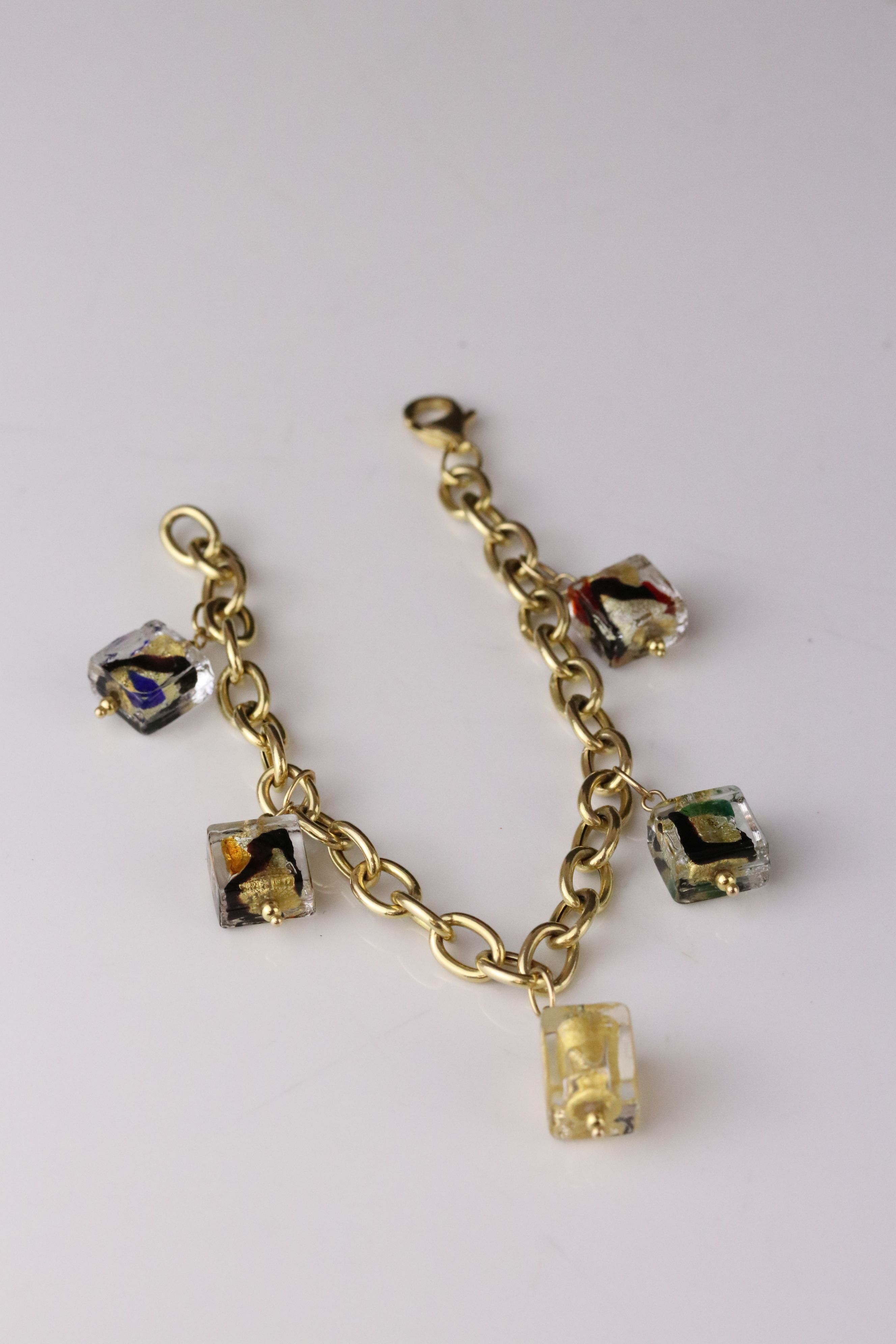 14ct yellow gold charm bracelet with five Murano style glass charms, lobster clasp, length approx