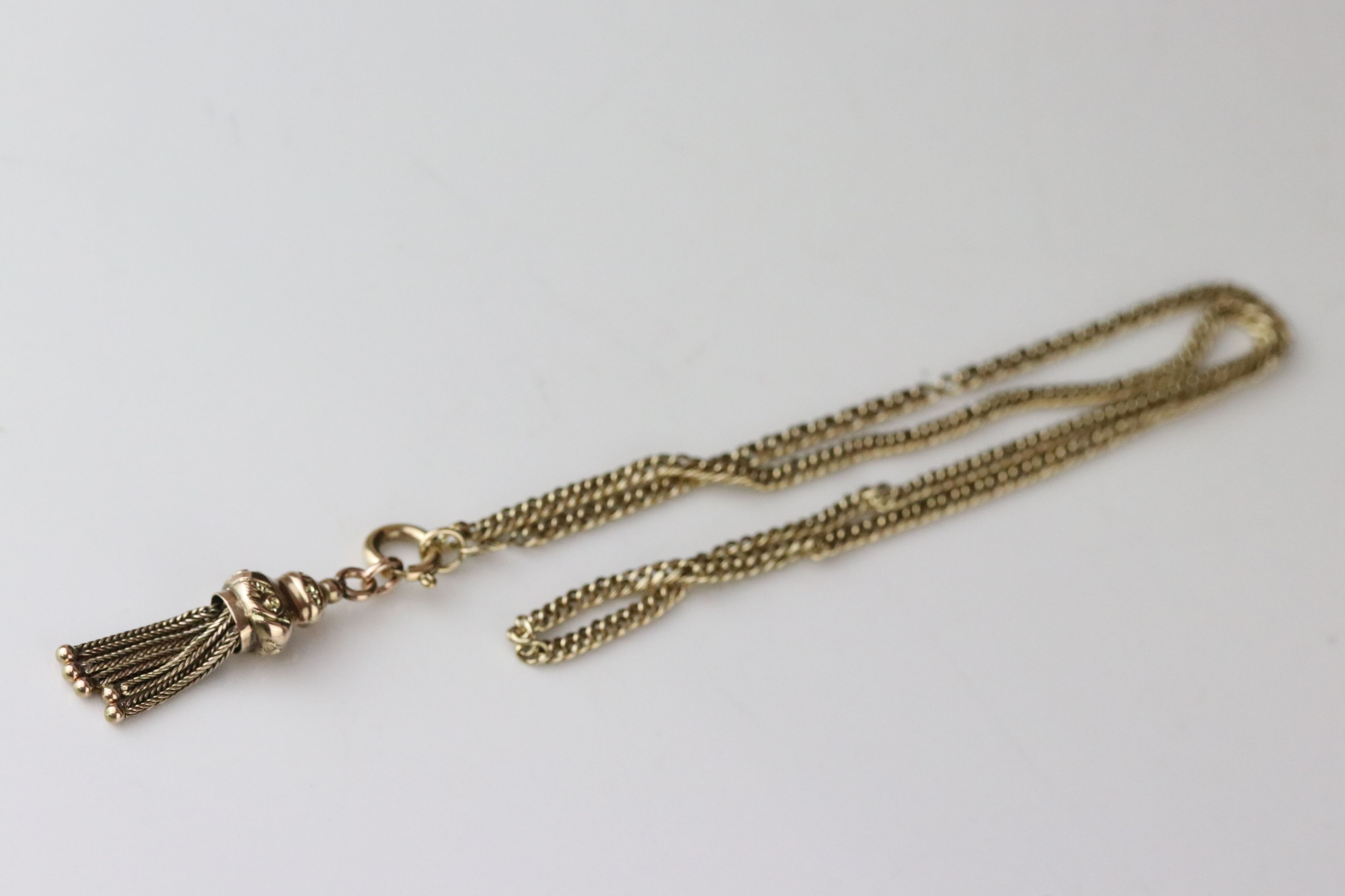 9ct gold chain with earlier tassel fob, length approx 49cm