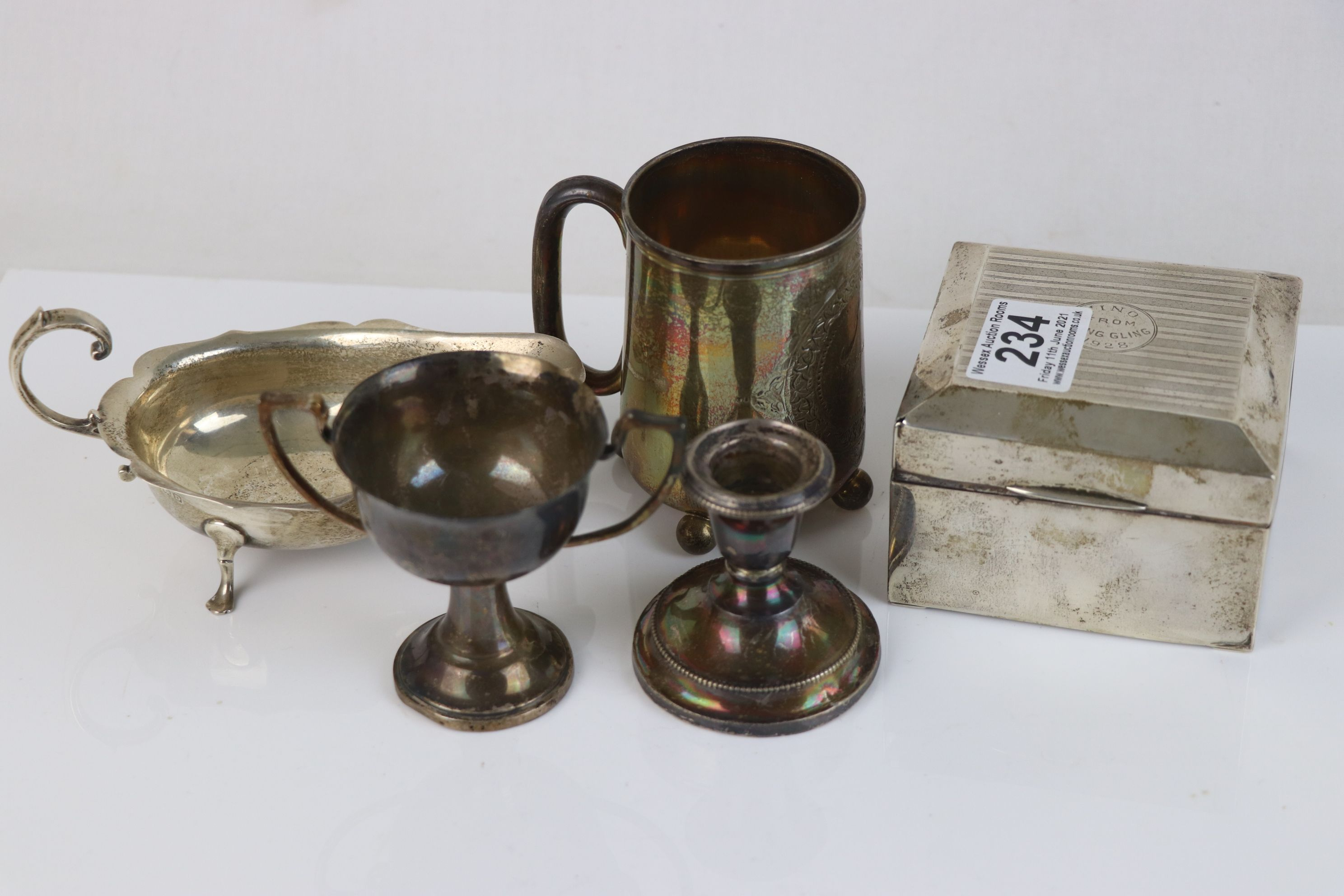 A collection of fully hallmarked sterling silver collectables to include Cigarette box, Trophy, Cup,