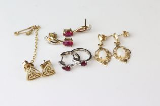 Four pairs of 9ct gold drop and stud earrings to include opals and rubies (4)