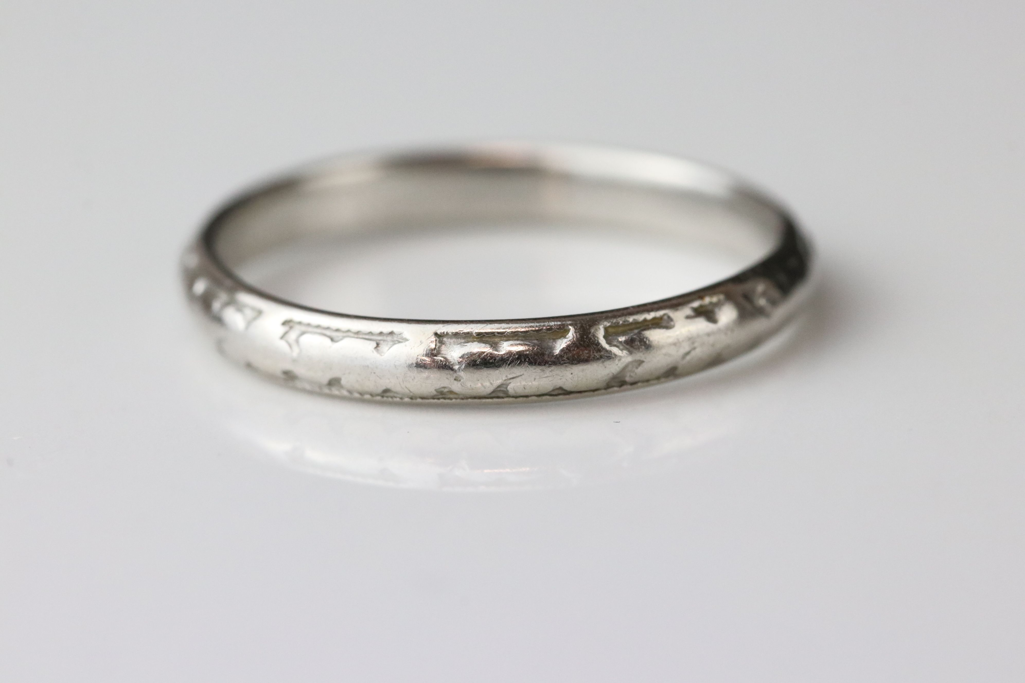 Platinum wedding band, worn foliate design, width approx 2.5mm, ring size M - Image 2 of 4