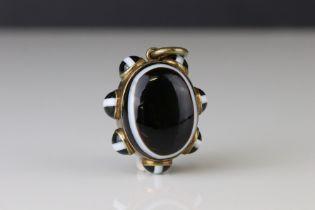Victorian bulls eye agate pinchbeck pendant, the central oval cabochon cut bulls-eye agate measuring
