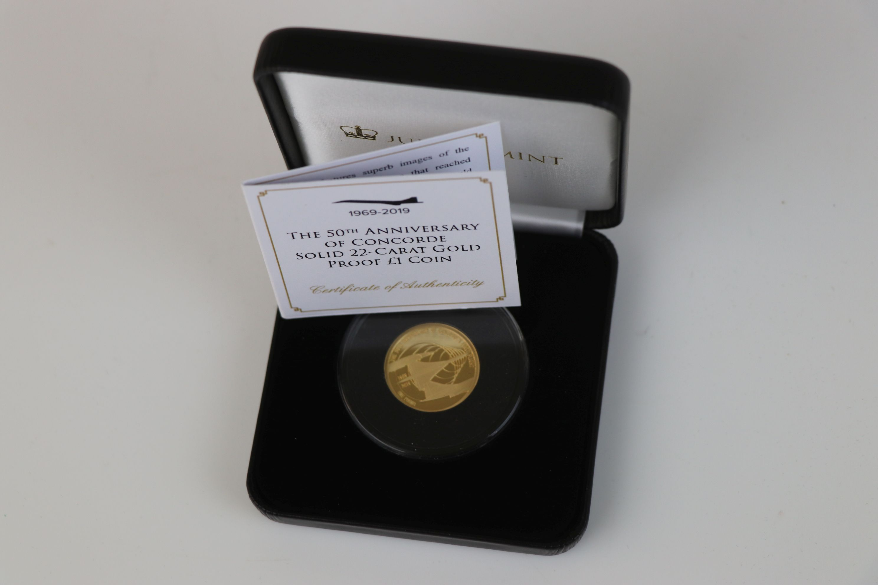 A cased Jubilee Mint The 50th Anniversary of Concorde 22ct gold proof £1 coin, complete with C.O. - Image 2 of 5