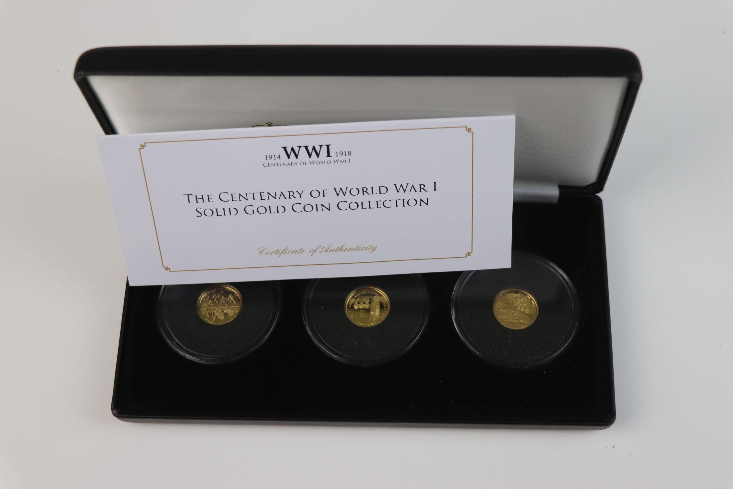 A cased Jubilee Mint limited edition The Centenary of World War One 9ct gold three coin set, - Image 7 of 7