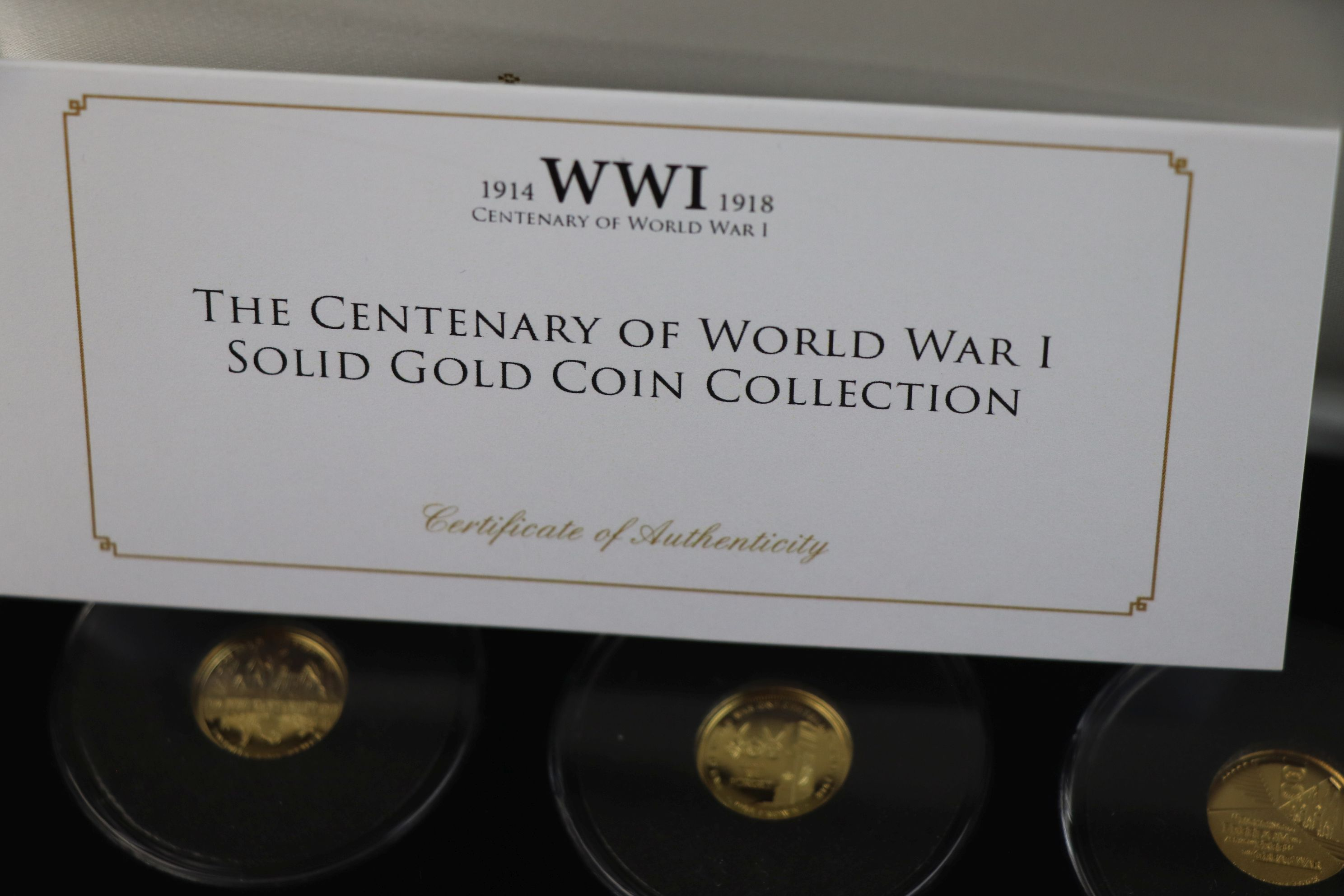 A cased Jubilee Mint limited edition The Centenary of World War One 9ct gold three coin set, - Image 6 of 7