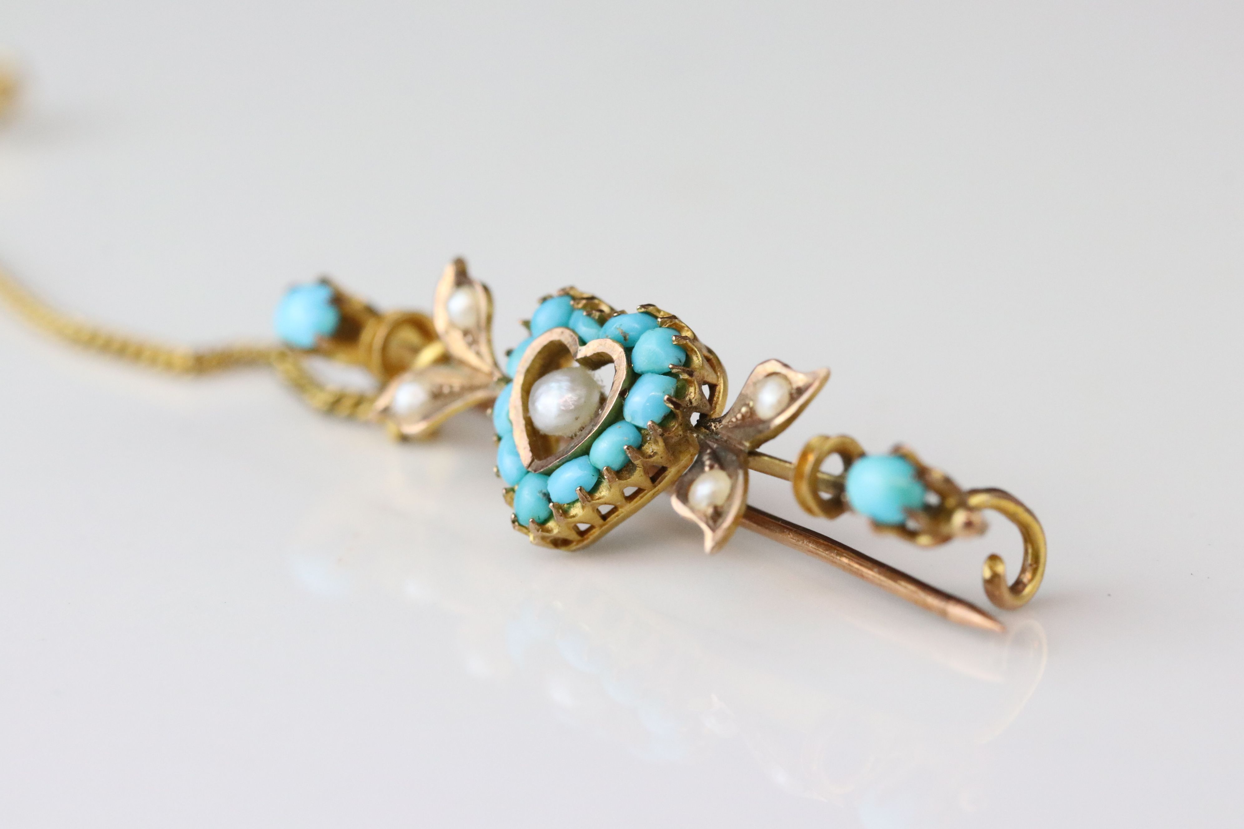 German 19th century turquoise and seed pearl 8ct gold sweetheart brooch, the central heart-shaped - Image 3 of 5