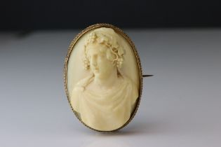 Victorian ivory cameo unmarked yellow gold oval brooch, the ivory cameo depicting female bust with