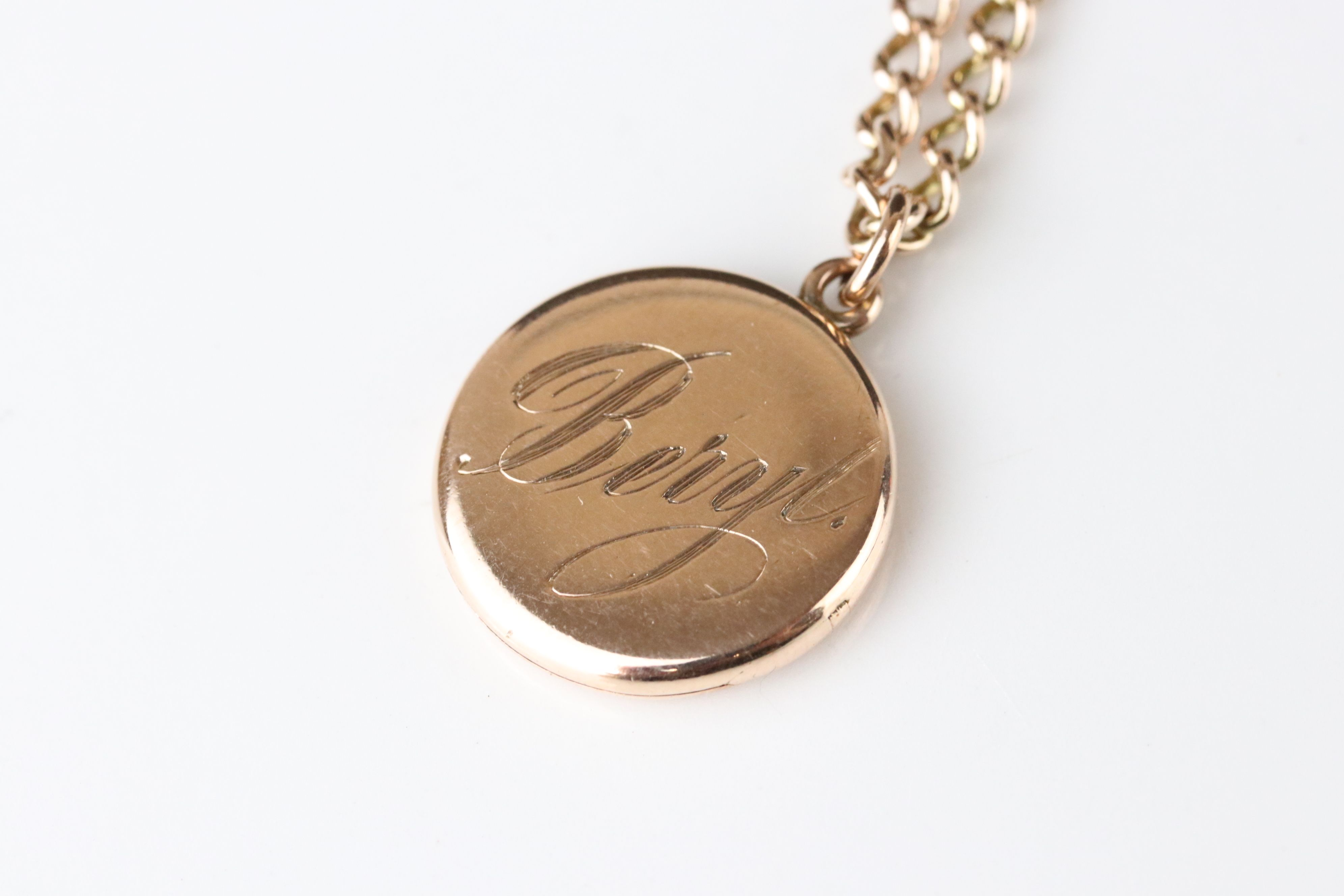 10ct yellow gold locket pendant engraved Beryl, containing hair to glazed compartment, on 9ct rose - Image 2 of 3