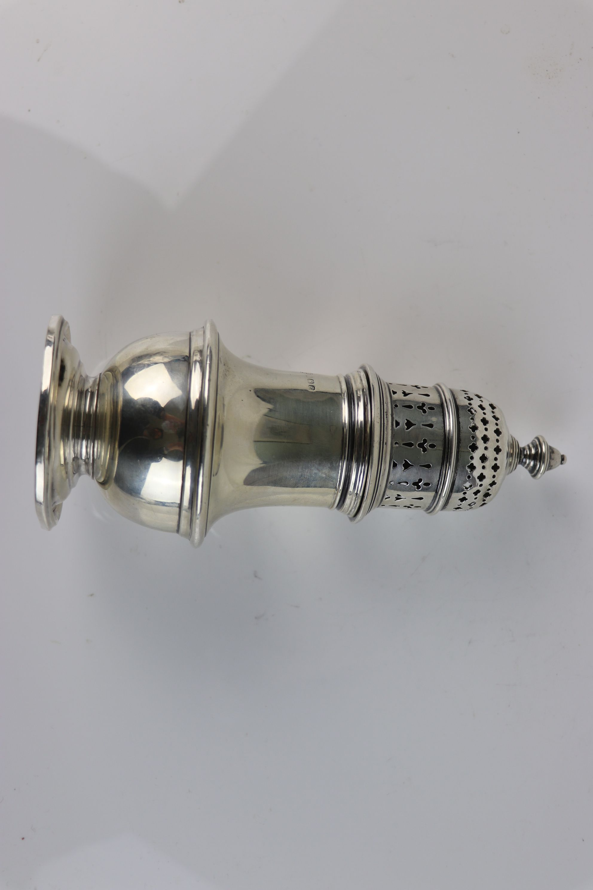A fully hallmarked sterling silver sugar caster, maker marked for Selfridge & Co Ltd, assayed in