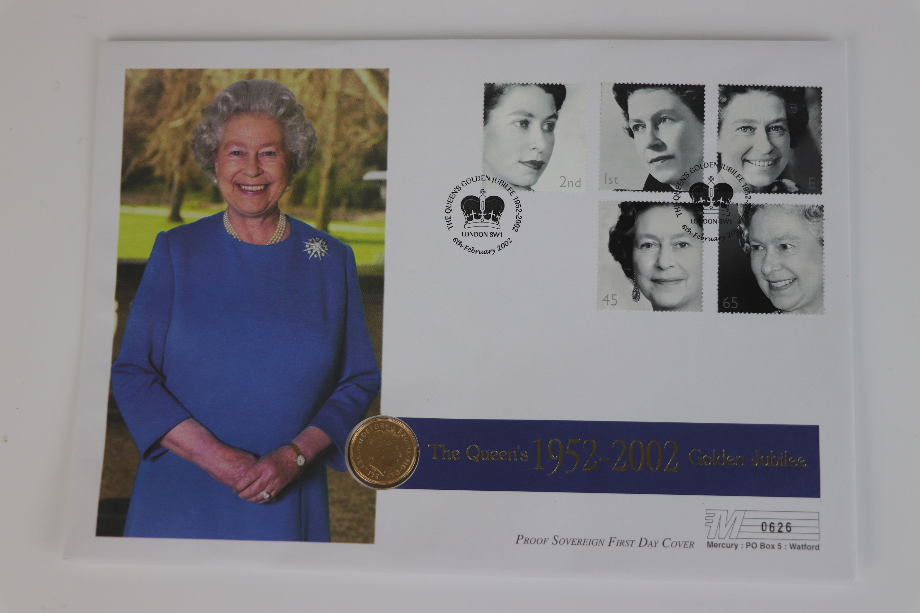 A 2002 Great Britain gold proof Sovereign coin cover.