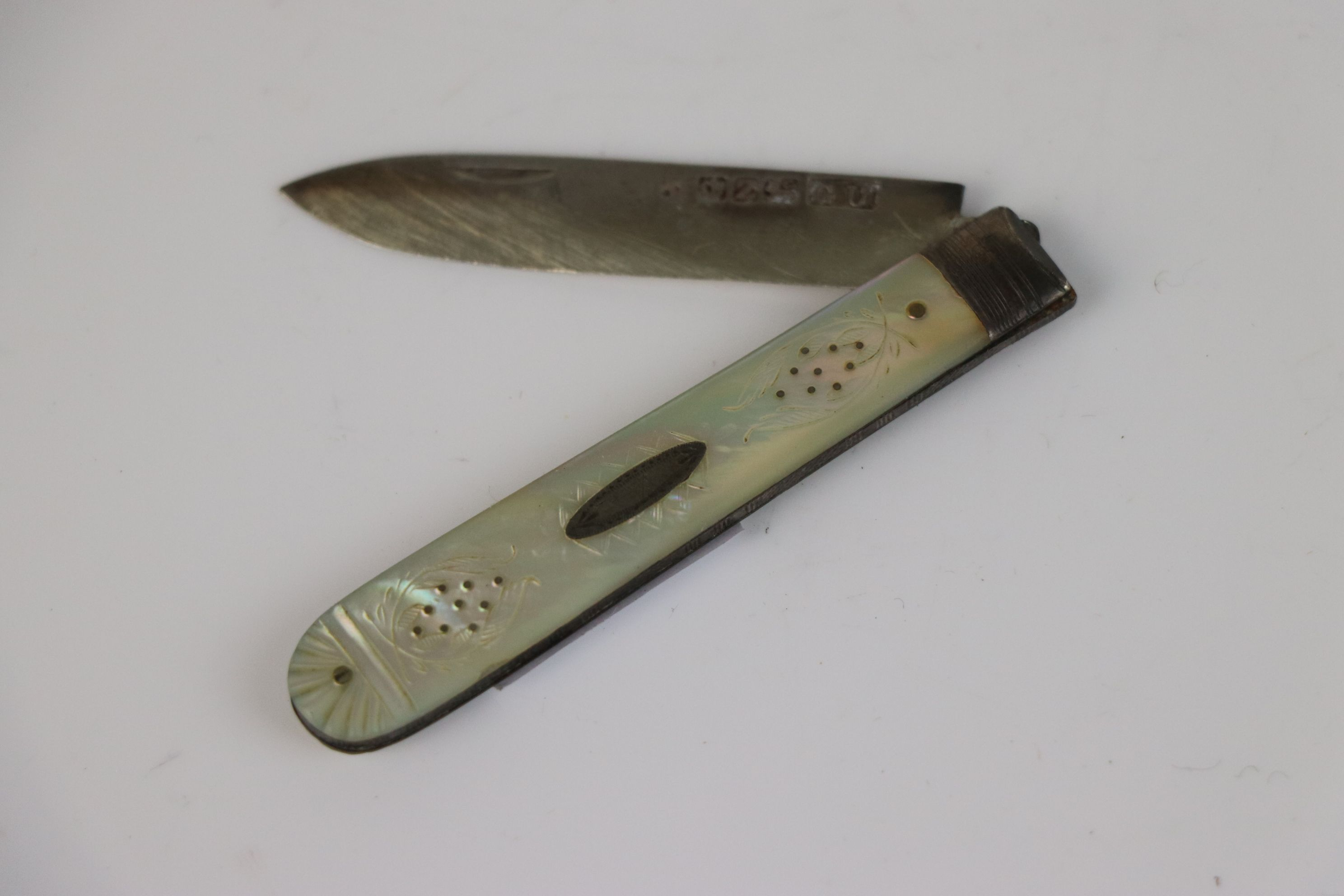 A fully hallmarked sterling silver and mother of pearl fruit knife, maker marked for George