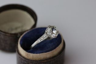 Diamond solitaire unmarked white gold ring, the cushion cut diamond weighing approximately 1.25
