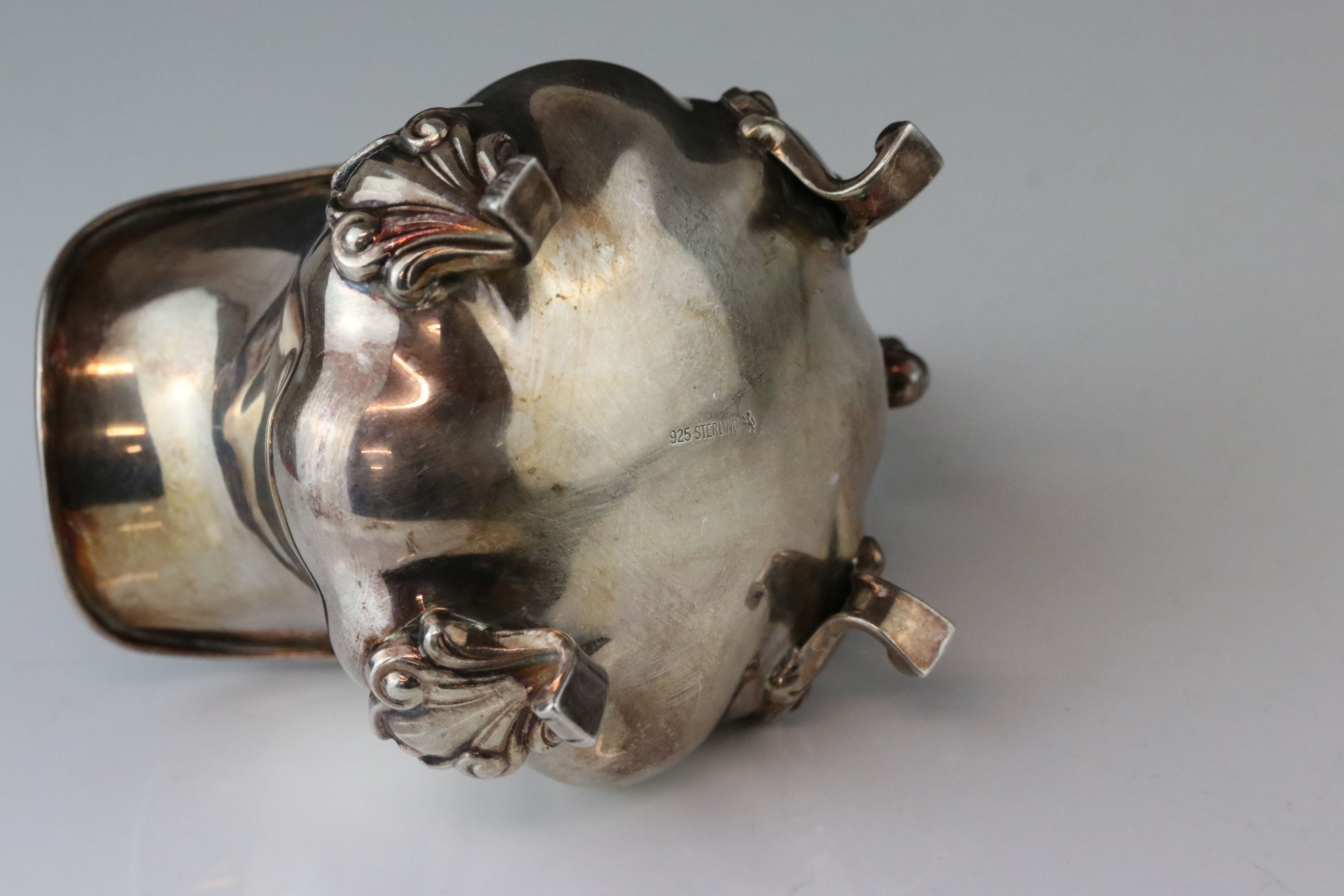 Silver cream jug raised on four scroll feet, bulbous body, acanthus leaf scroll handle, stamped - Image 4 of 9