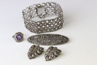 Marcasite silver jewellery to include a panel bracelet, pierced form, tongue and box clasp with