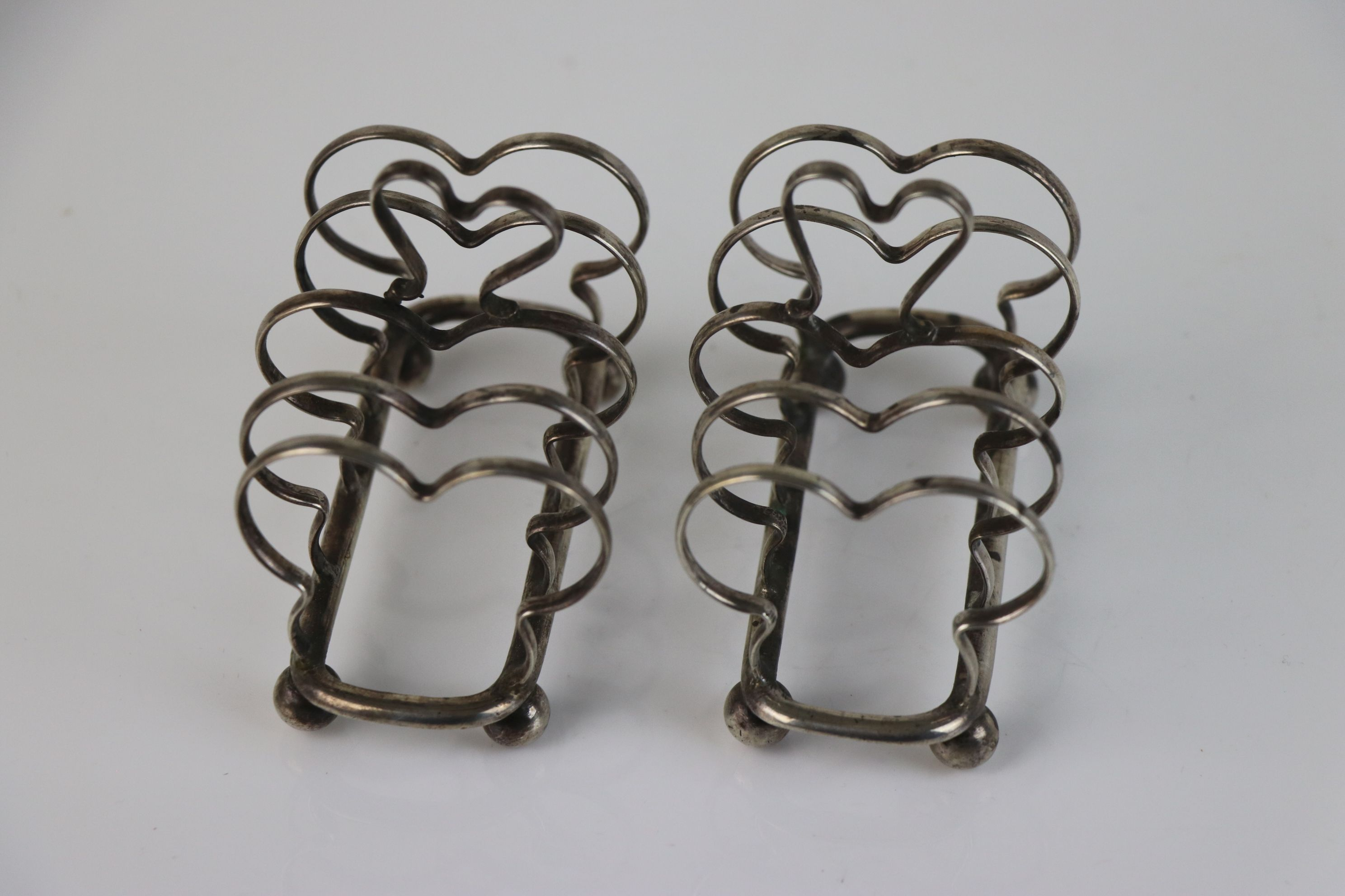 A pair of fully hallmarked sterling silver bread shaped toast racks with ball feet, maker marked for - Image 3 of 5