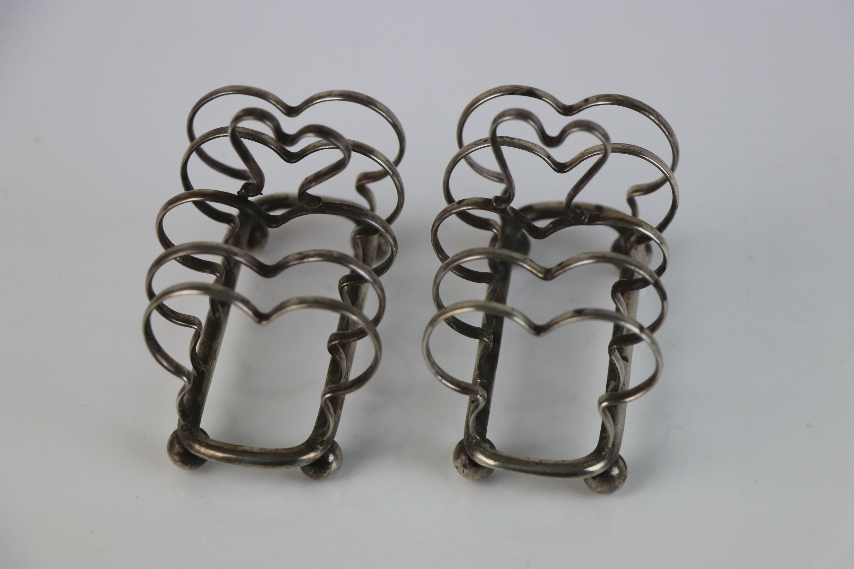 A pair of fully hallmarked sterling silver bread shaped toast racks with ball feet, maker marked for - Image 4 of 5
