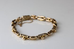 Edwardian yellow metal fancy link bracelet, tongue and box patented clasp, safety chain, length
